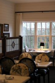 The dining room of Aurora restaurant Filberts Farmhouse Kitchen, pictured here on Jan 3, 2019, is built as an extension to an 1865 farmhouse and decorated with antiques.