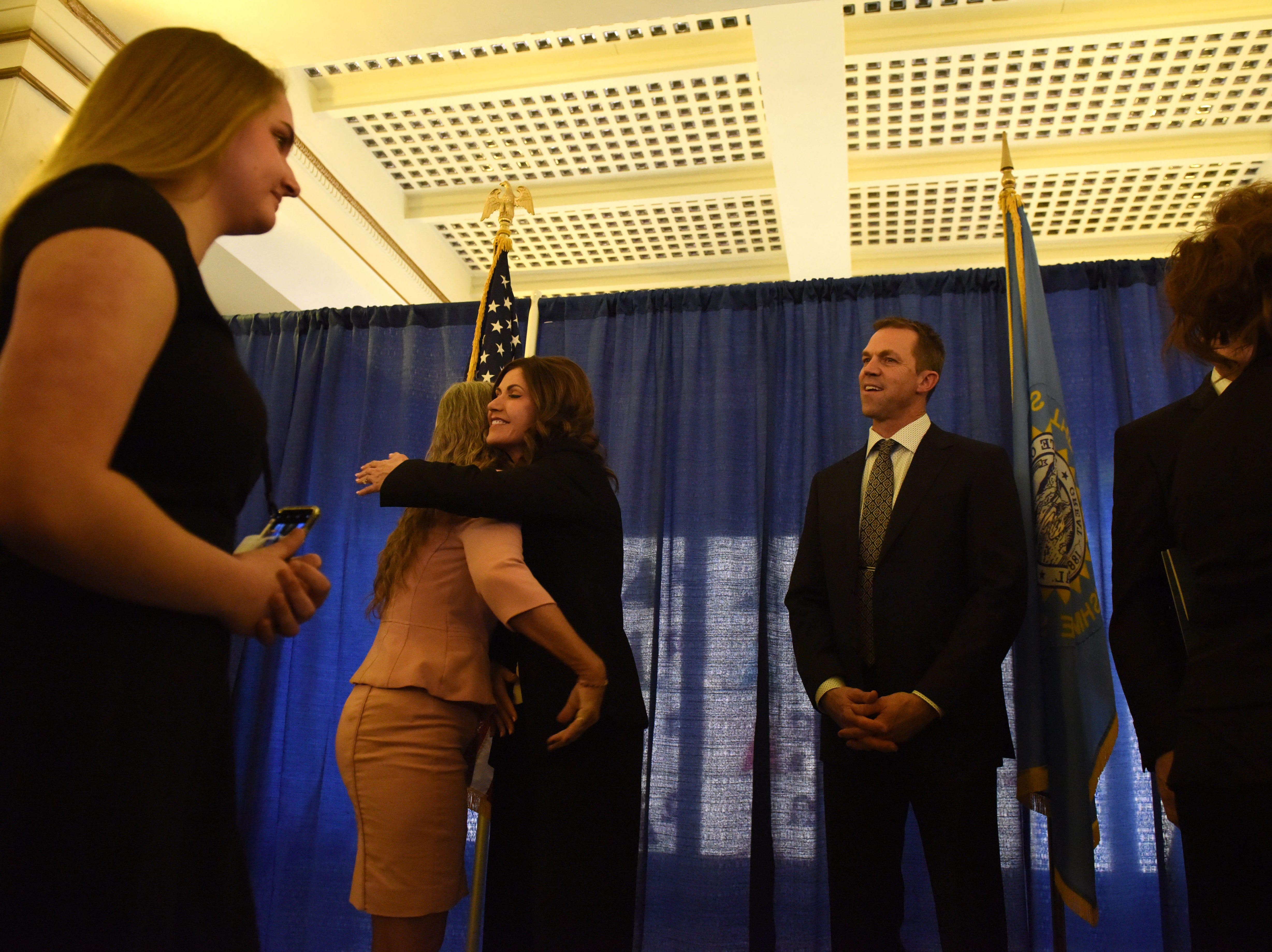 Gov. Kristi Noem hugs someone at the receiving line Saturday, Jan. 5, 2019, after being sworn-in as South DakotaÕs 33rd and first female governor in Pierre, S.D.