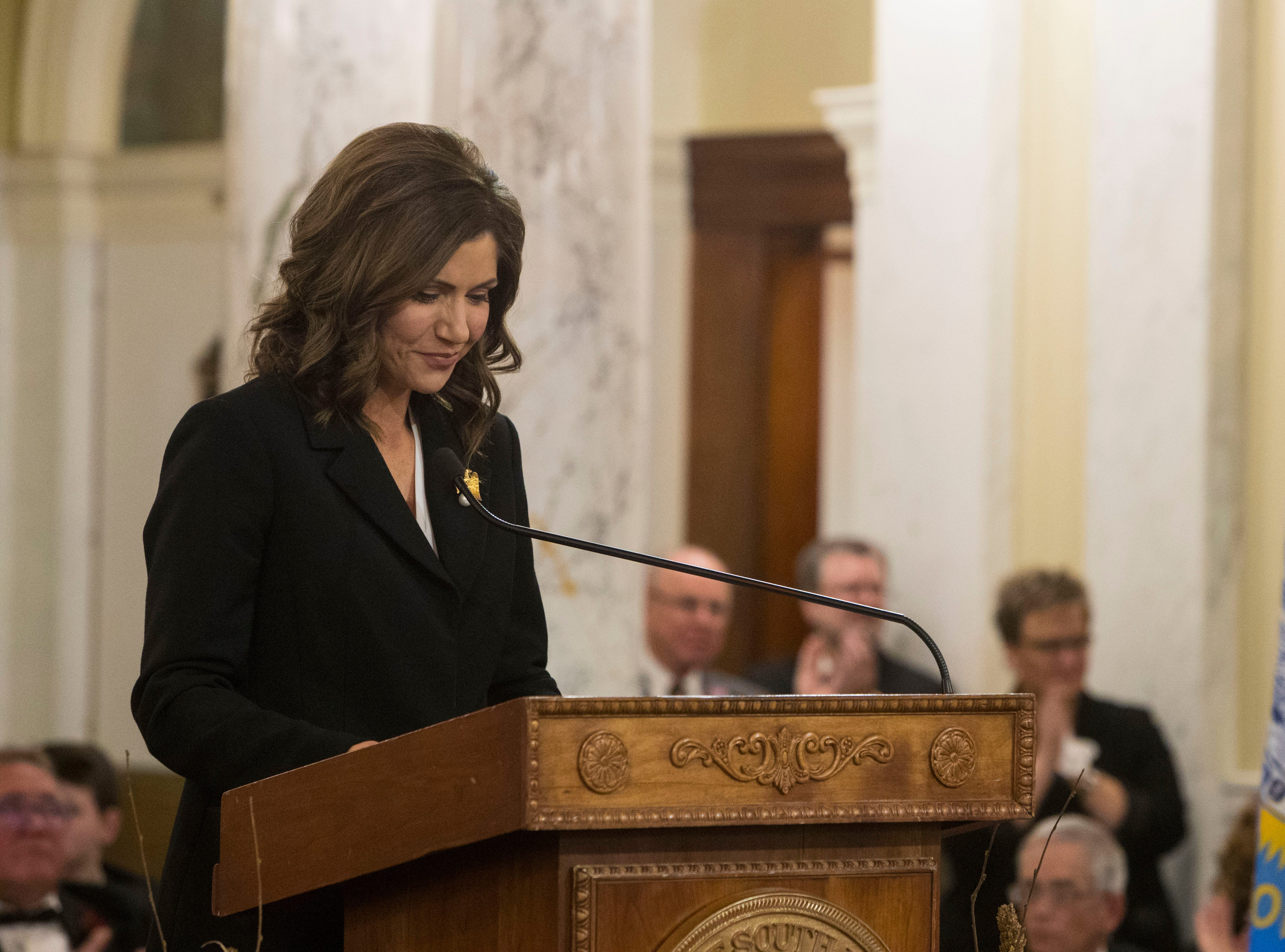 Gov. Kristi Noem reacts during her speech Saturday, Jan. 5, 2019, after being sworn-in as South DakotaÕs 33rd and first female governor in Pierre, S.D.