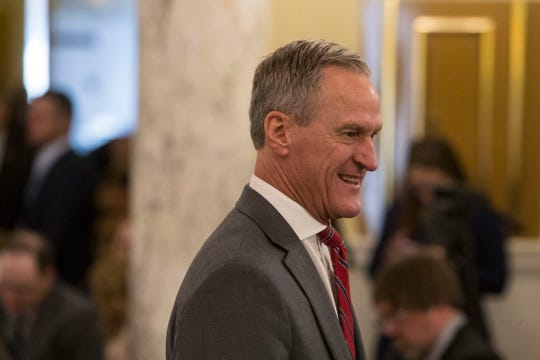 Former Gov. Dennis Daugaard attends Gov. Kristi Noem's inauguration ceremony in Pierre, S.D., Saturday, Jan. 5, 2019.