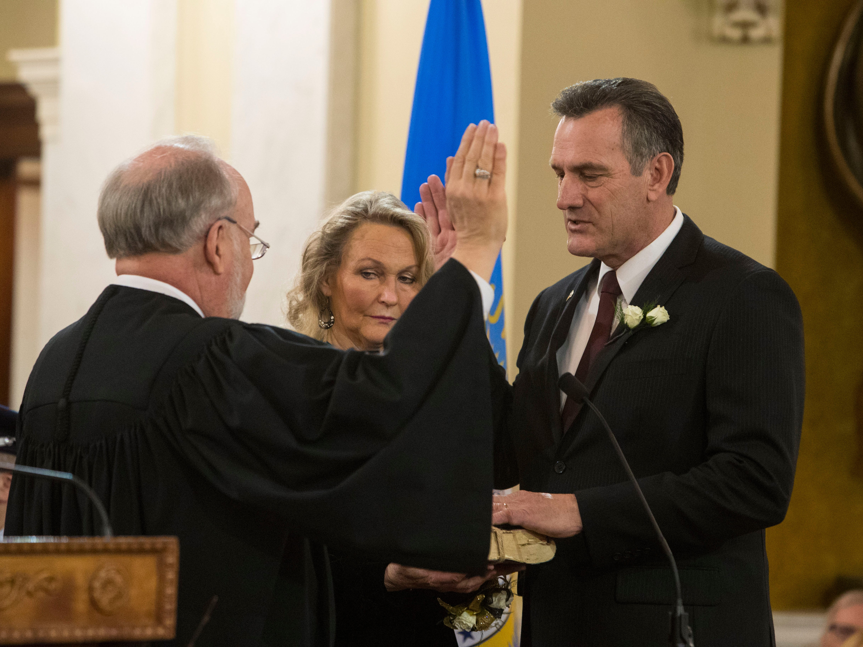 Lt. Gov.-elect Larry Rhoden is sworn, Saturday, Jan. 5, 2019 in Pierre, S.D.
