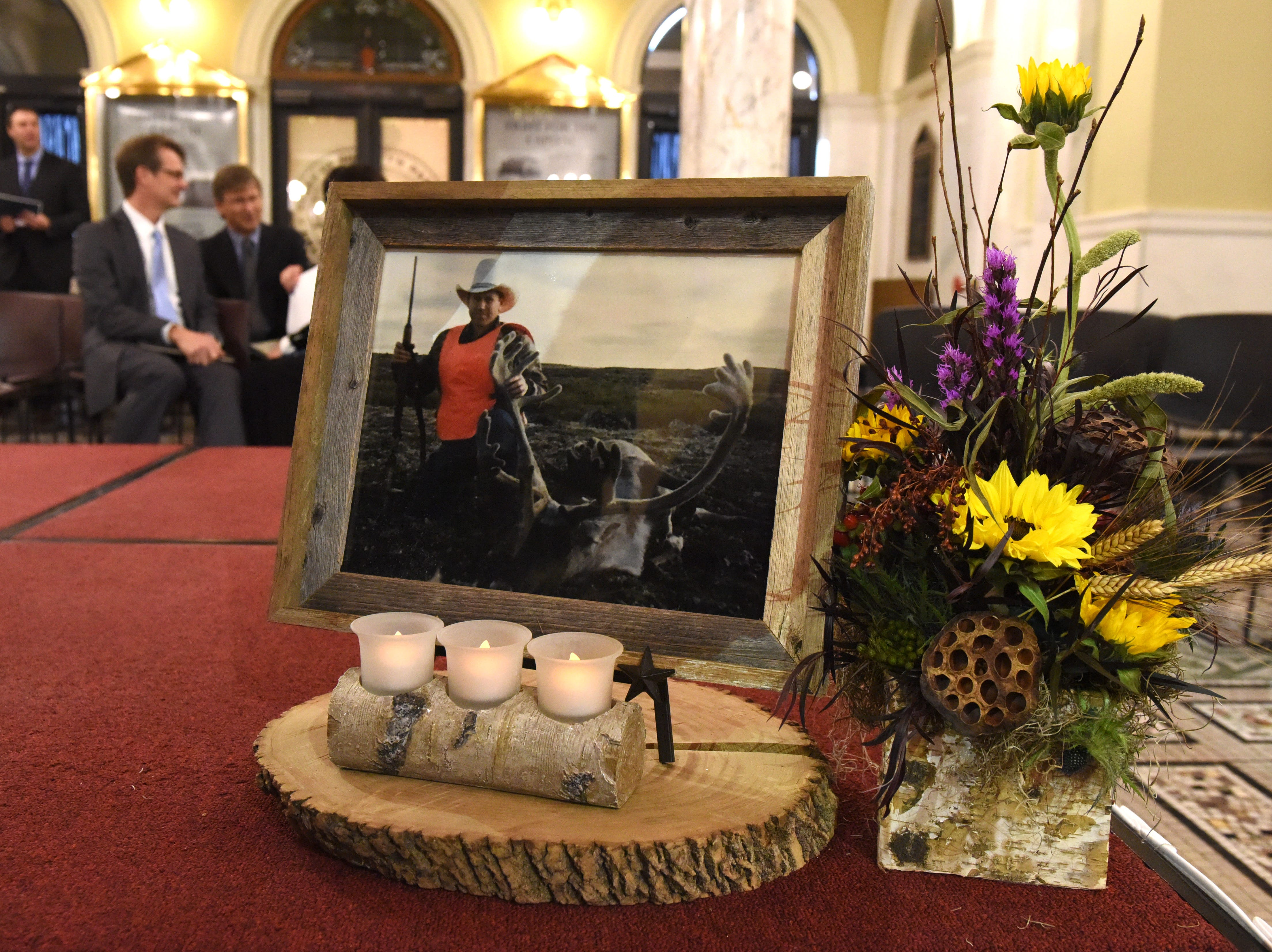 A photo of Gov. Kristi Noem's father is displayed on the platform where she gave her Oath of Office Saturday, Jan. 5, 2019 in Pierre, S.D.