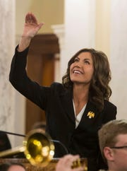 Gov. Kristi Noem waves to the people in attendance at her inauguration ceremonies on Saturday at the capitol building in Pierre.