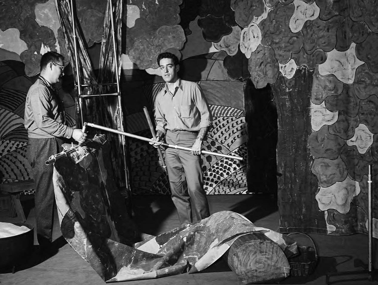 "Cast members of Southwest Missouri State College's play """"Finian's Rainbow."" Byrne Blackwood and Nelson Park adjusted portable scenery designed to fit in 30-inch foot lockers. Published in the News & Leader on March 5, 1961."