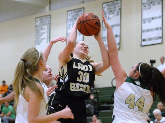 Buffalo Gap's Sage Massie takes the ball up for a shot against Wilson Memorial's Reagan Frazier Friday night.