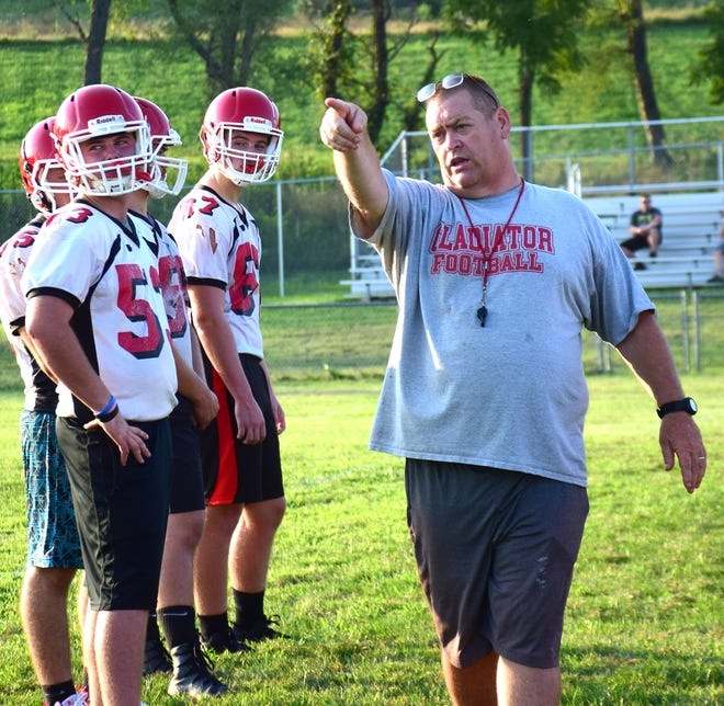 Riverheads head football coach Robert Casto directs his players during the first practice of the 2018 season in August. Casto stepped down as head coach on Wednesday, Jan. 2, 2019, after 23 years.