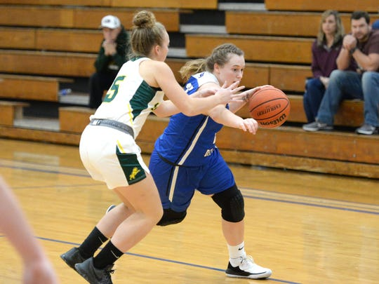 Fort Defiance's Meredith Lloyd drives around her defender Saturday at the Play of Preemies Showcase at Western Albemarle High School.