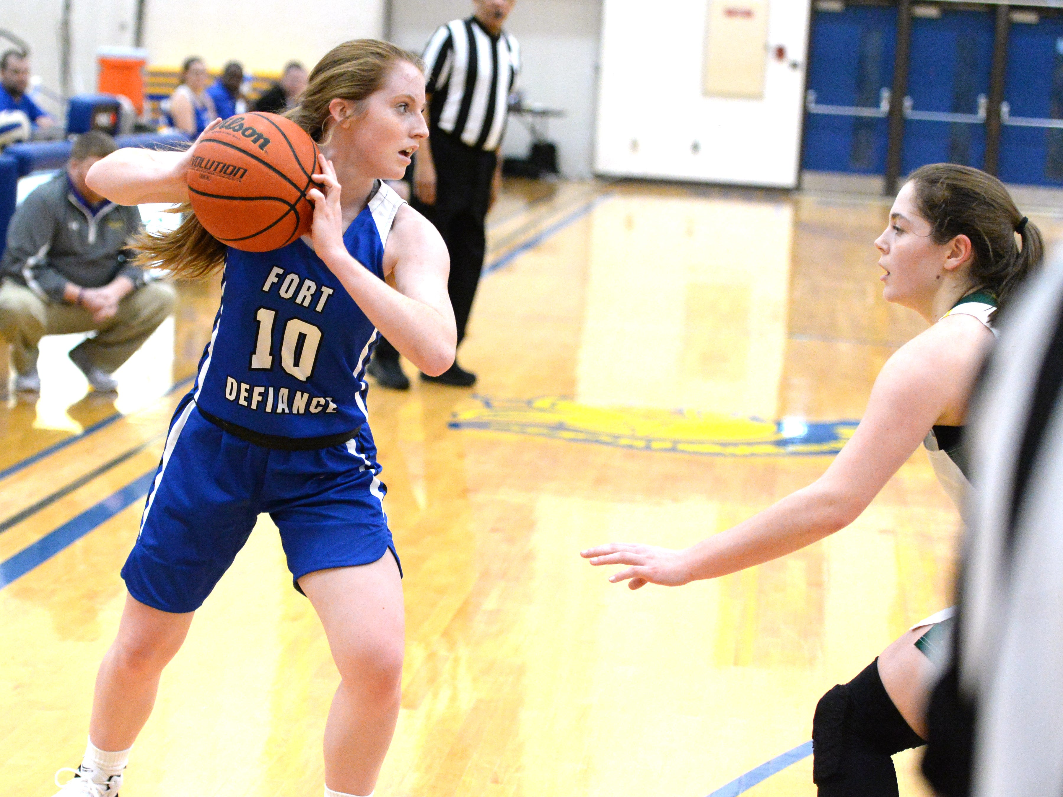 Fort Defiance's Bri Allen looks for an open teammate Saturday at the Play of Preemies Showcase at Western Albemarle High School.