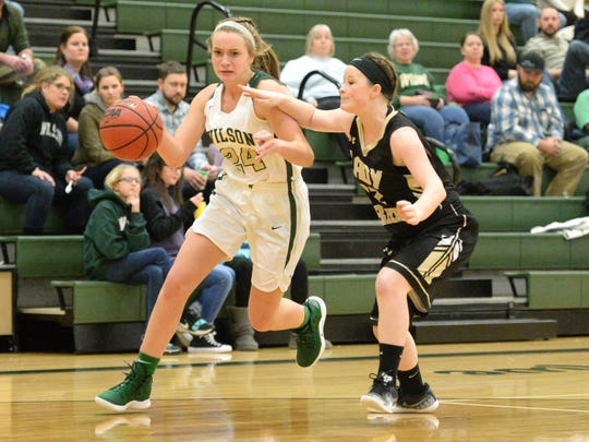 Wilson Memorial's Brooke Cason drives around Buffalo Gap's Kyleigh Shifflett
