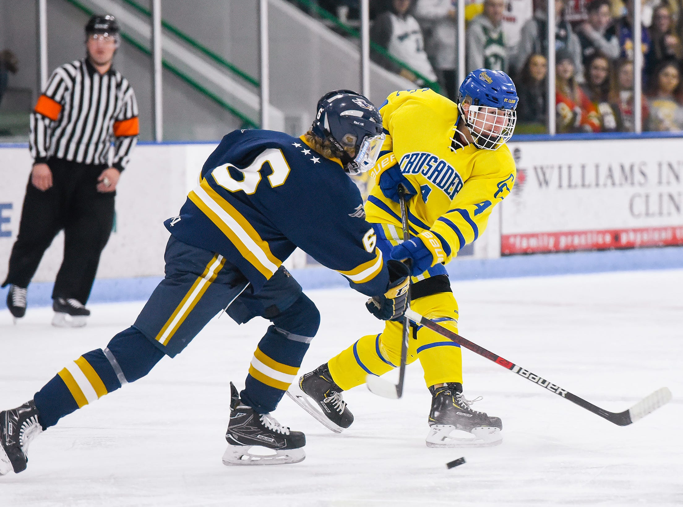 St. Cloud Cathedral's Jon Bell make a pass around Hermantown's Aydyn Dowd during the first period Friday, Jan. 4, at the MAC in St. Cloud.
