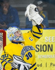 St. Cloud Cathedral goalie Noah Amundson stops a Hermantown shot during the first period Friday, Jan. 4, at the MAC in St. Cloud.