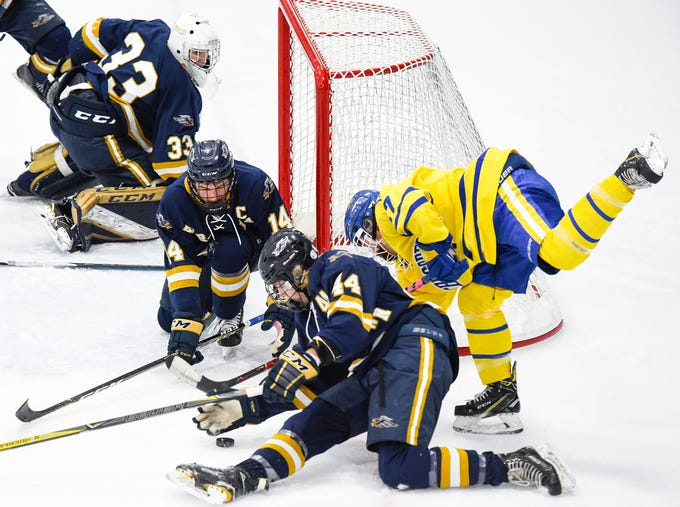 St. Cloud Cathedral's Blake Perbix tries to get the puck past the Hermantown defense during the first period Friday, Jan. 4, at the MAC in St. Cloud.