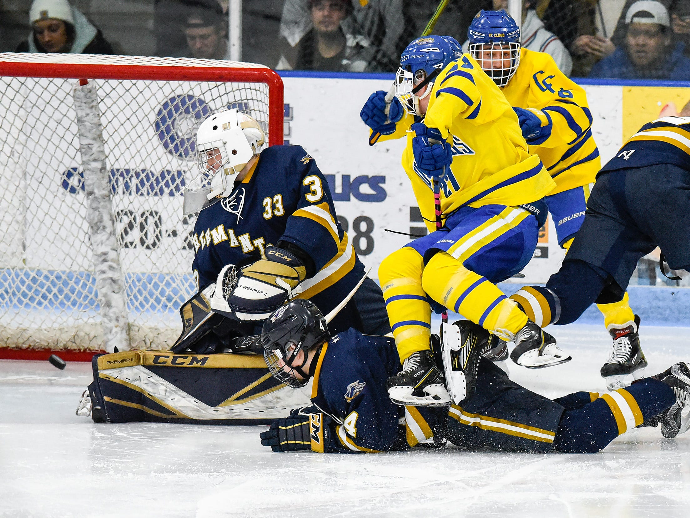 St. Cloud Cathedral's Blake Perbix, center, scores on Hermantown goalie Cole Manahan during the second period Friday, Jan. 4, at the MAC in St. Cloud.