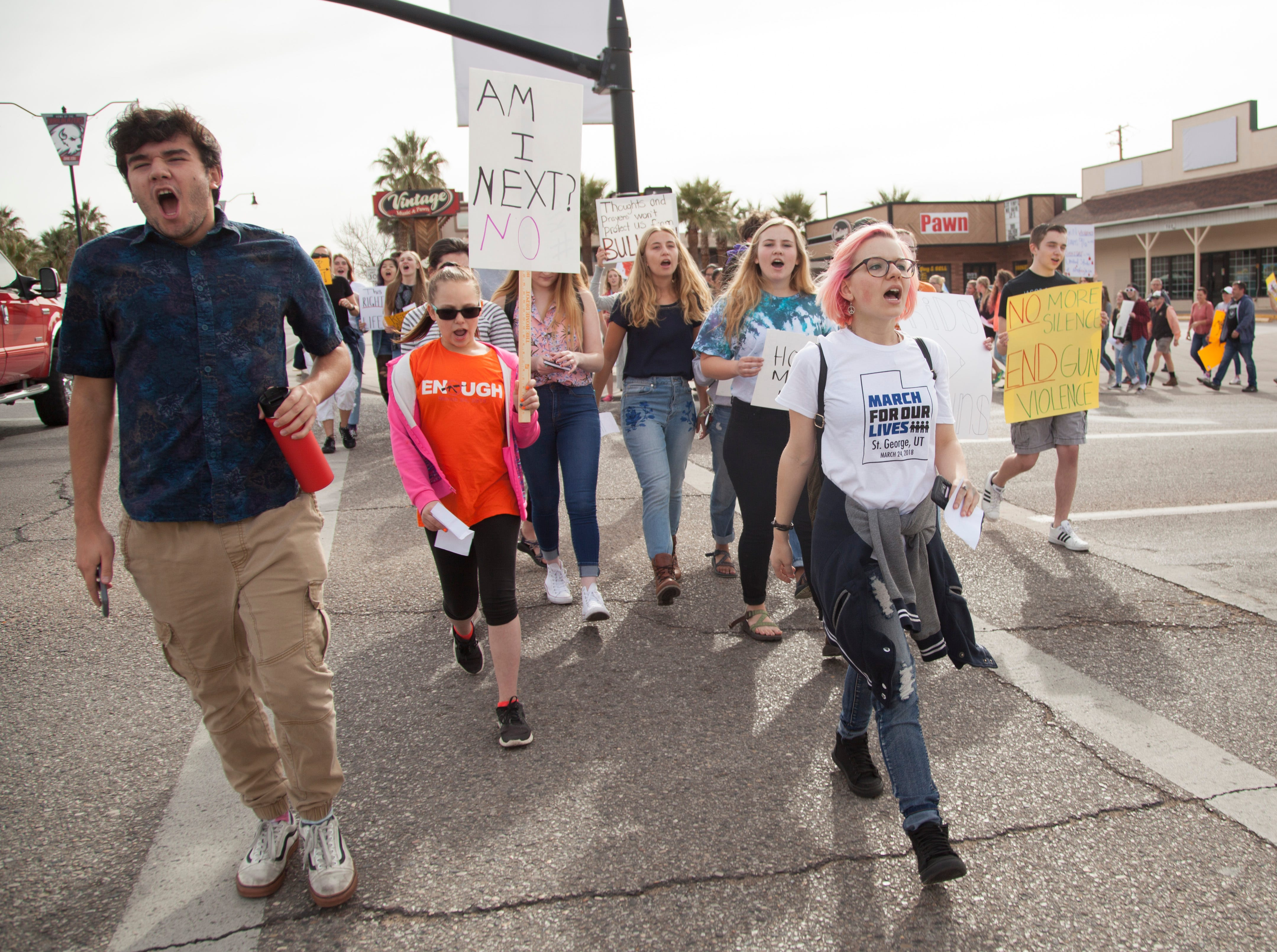 Members of the community, led by DSU students, participate in the March For Our Lives demonstration Saturday, March 24, 2018. Hundreds of participants marched from the DSU campus to the St. George City office.