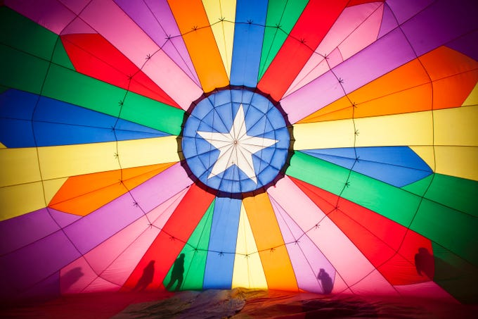 Hot air balloon pilots and fans gather at Sand Hollow Resort for the inaugural Sky Fest Saturday, Feb. 3, 2018.