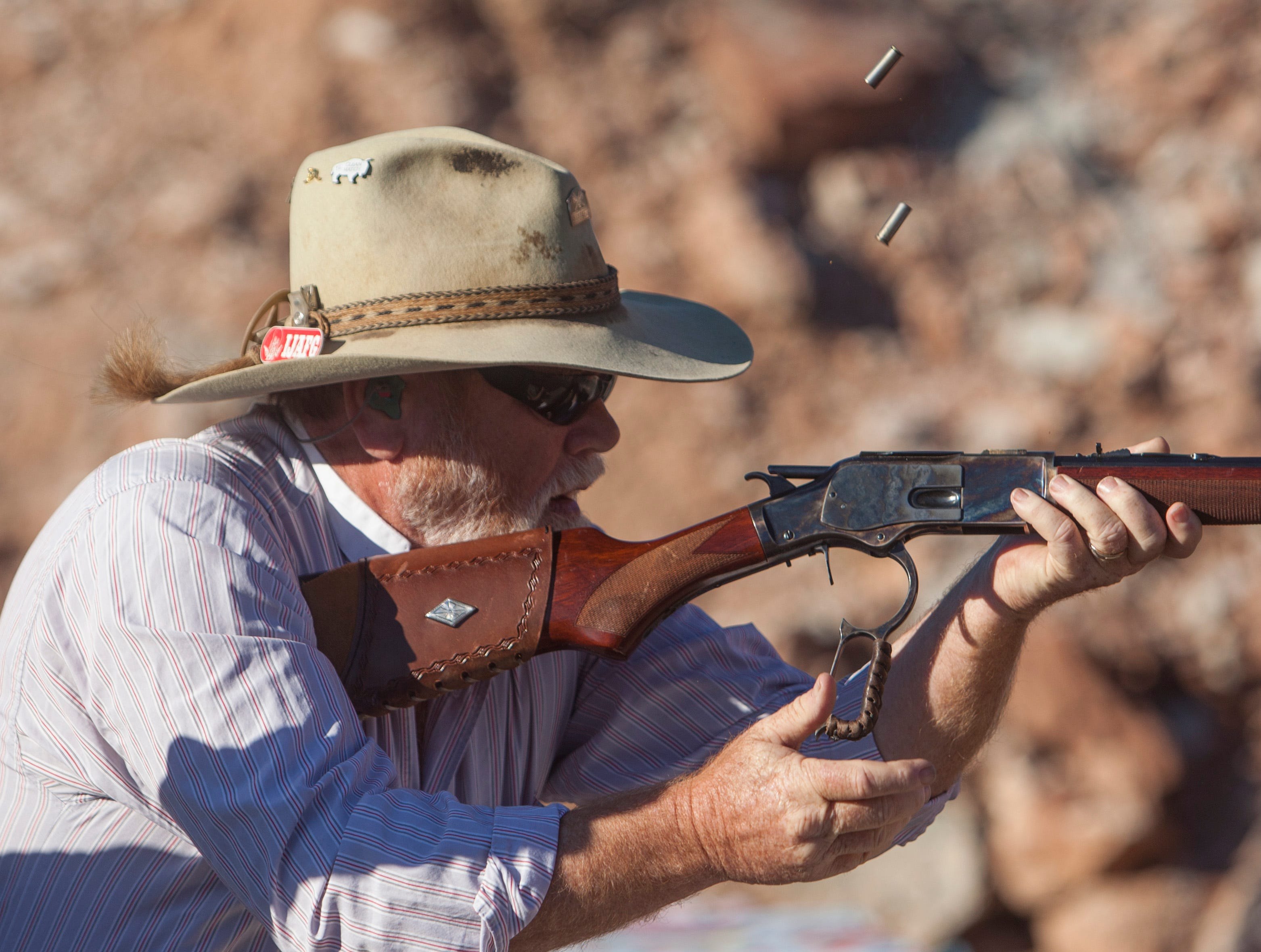 World Senior Games athletes compete in cowboy action shooting Friday, Oct. 12, 2018.
