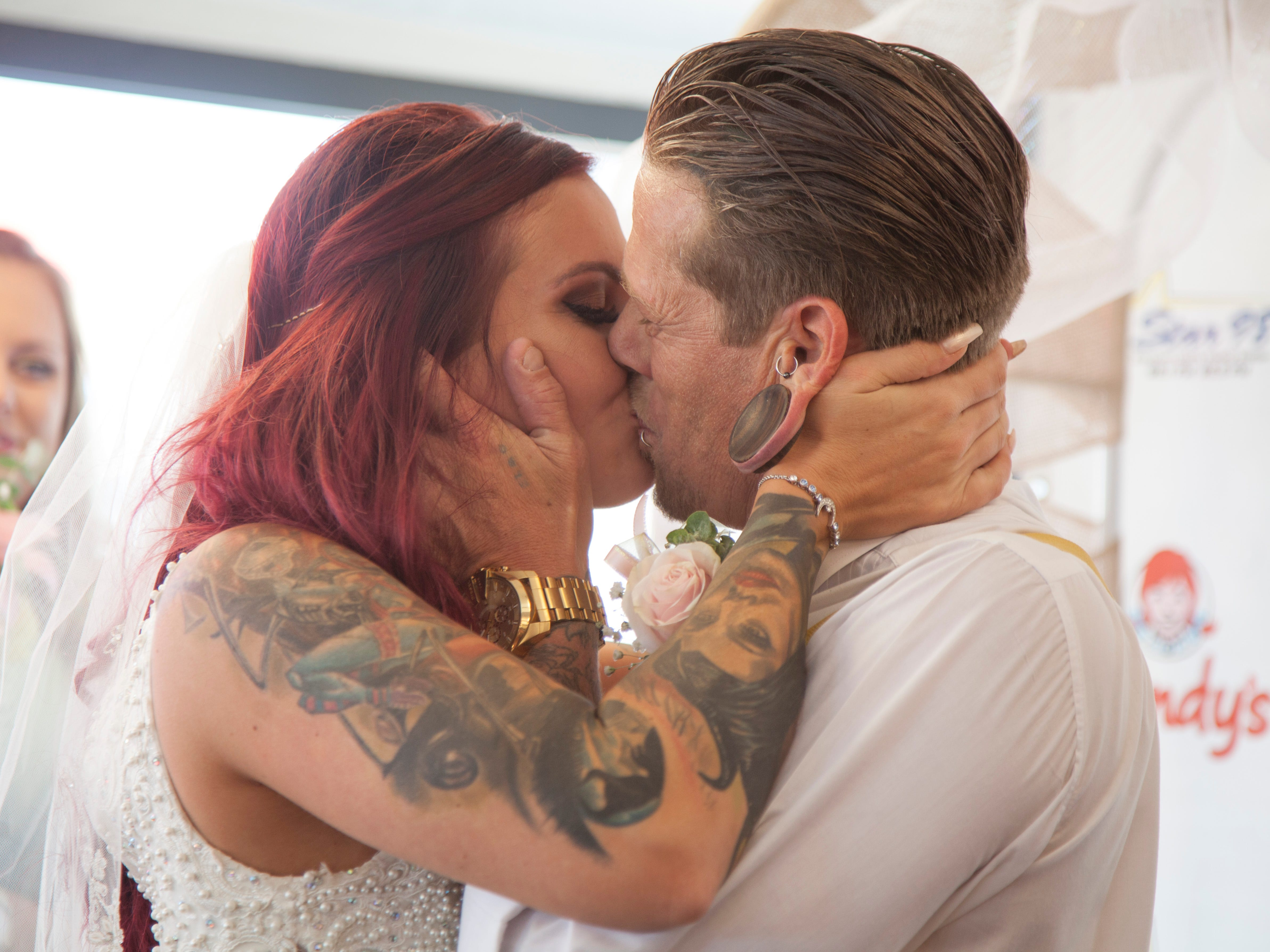 Abram and Jessica Thompson tie the knot at the St. George Boulevard Wendy's Restaurant Friday, June 22, 2018.