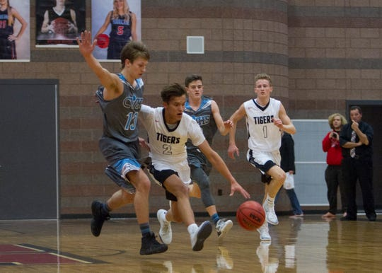 Hurricane guards Dallen Davis (2) and Bryce Thomas (1) will be important players in the Tigers' first round playoff matchup with the Payson Lions.