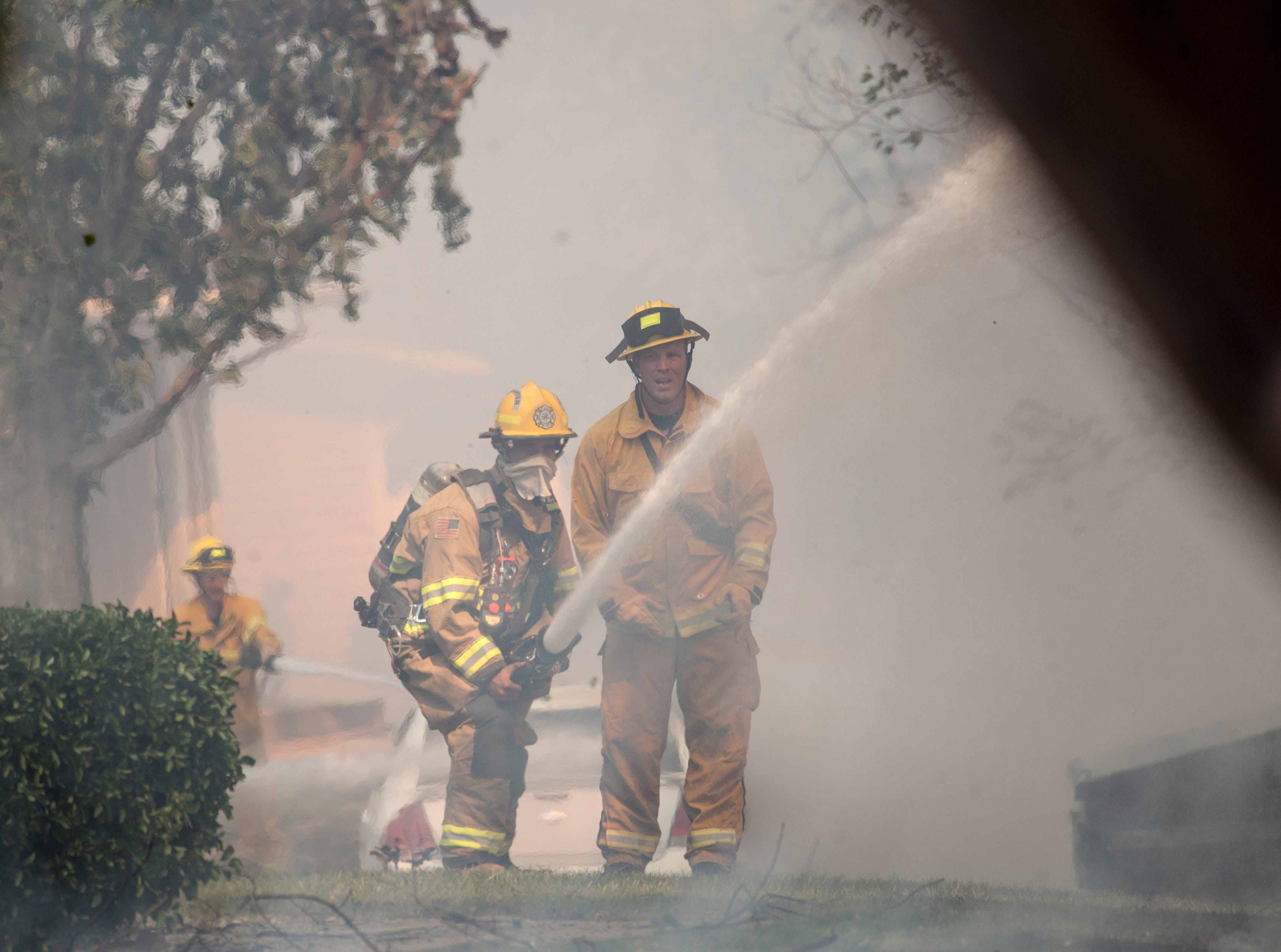 A brush fire near Springtree Garden Apartments threatens multiple structures and causes residents to evacuate Tuesday, May 8, 2018.