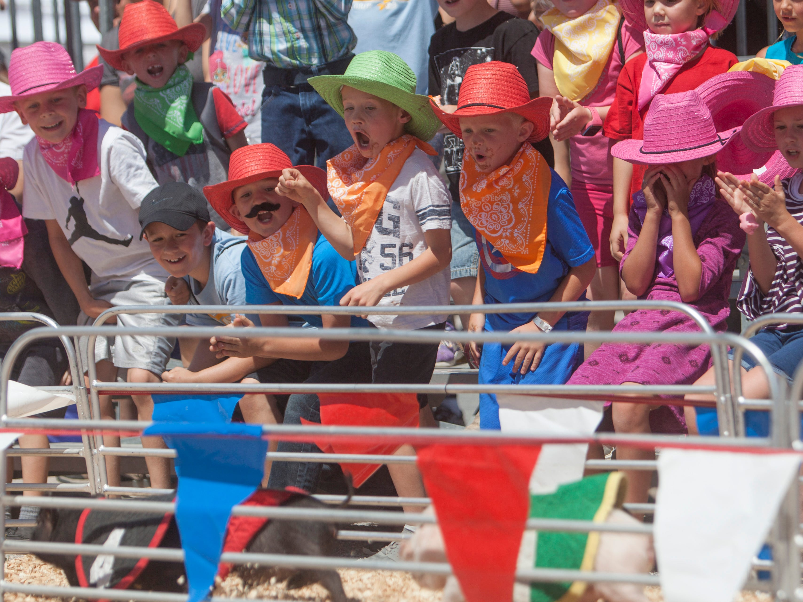 Fairgoers enjoy the attractions at the Clark County Fair and Rodeo Wednesday, April 11, 2018.