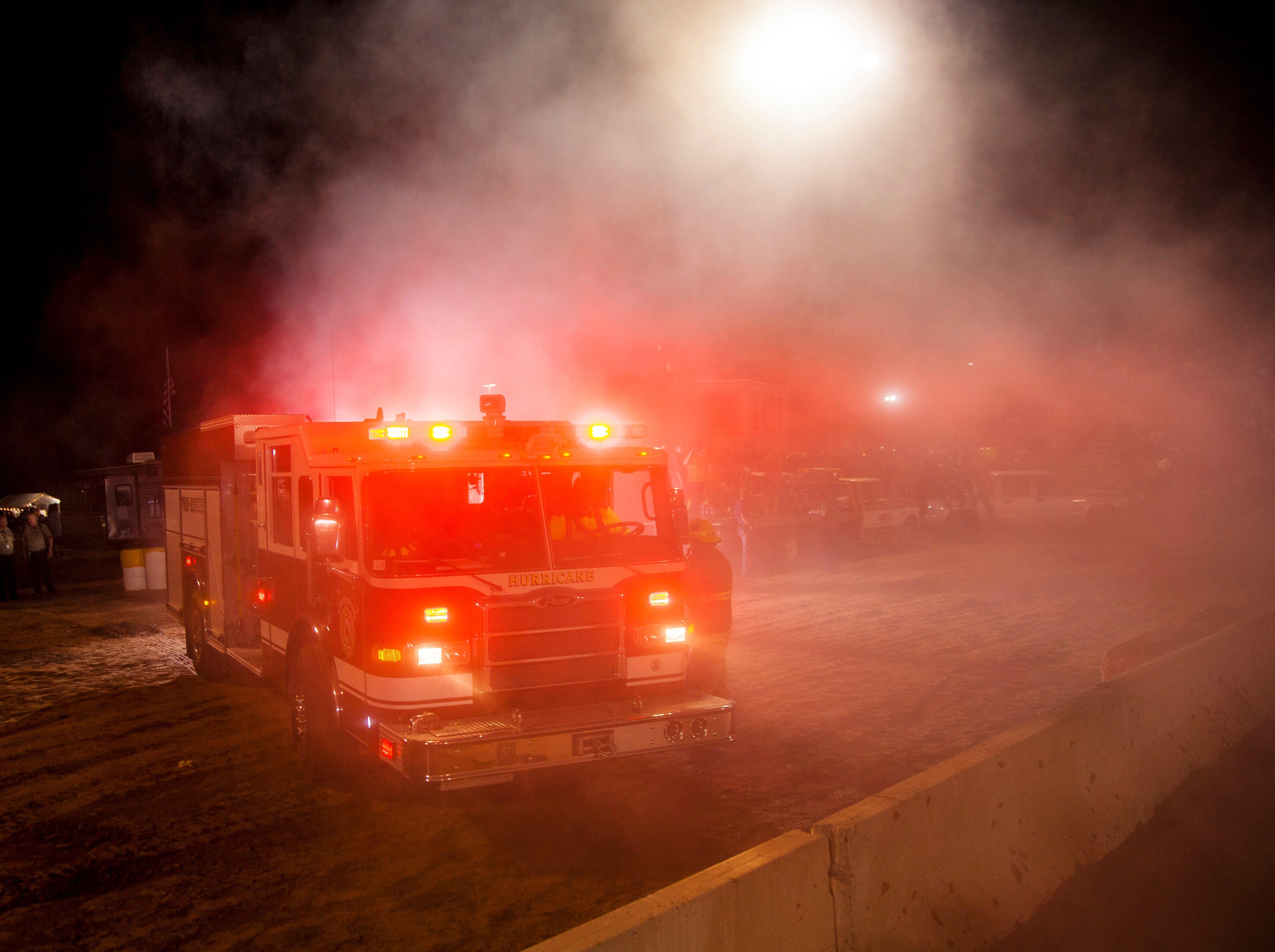 Fire trucks at the Washington County Fair approach a collision.