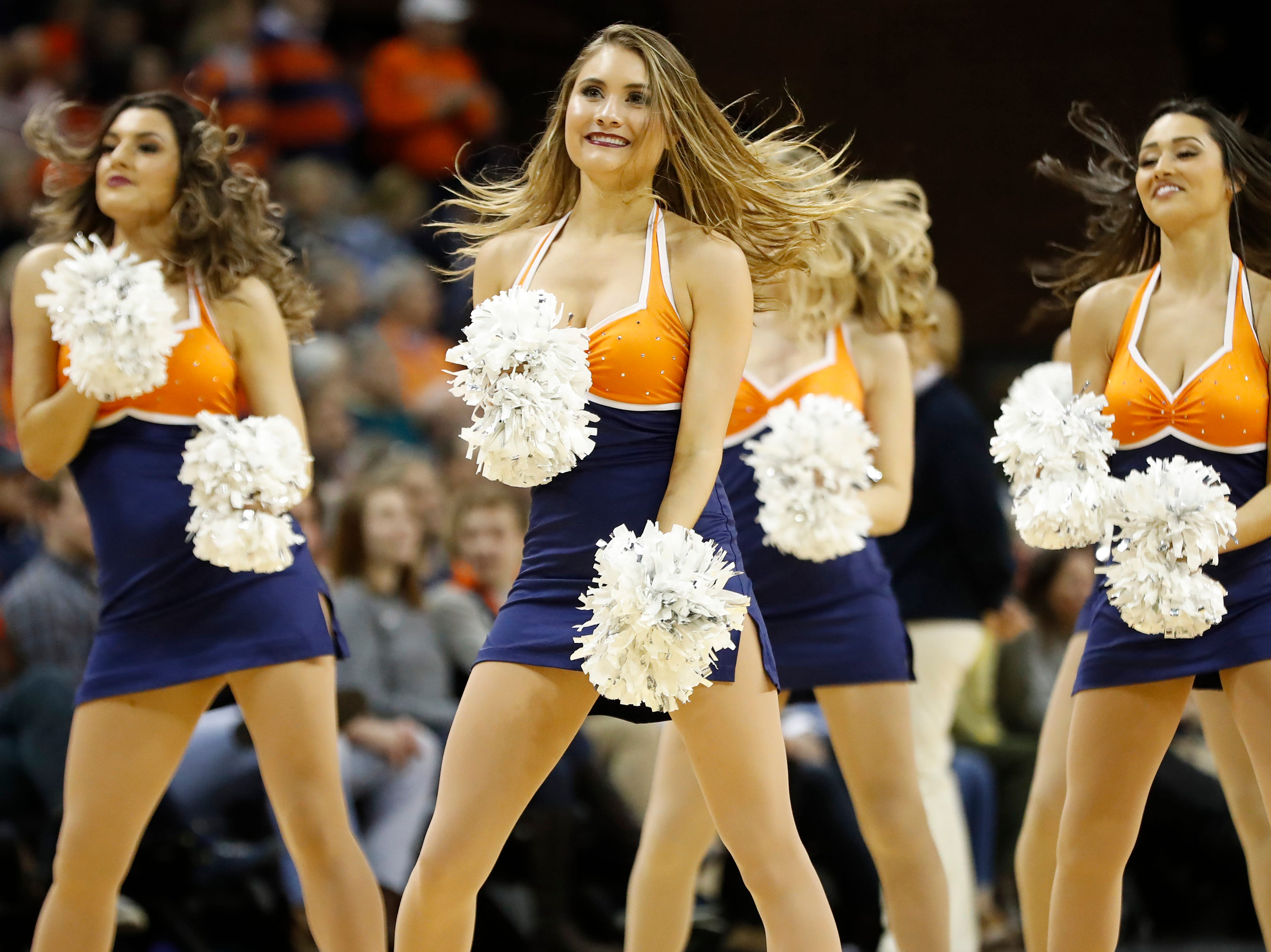 Jan 5, 2019; Charlottesville, VA, USA; Members of the Virginia Cavaliers dance team dance on the court during a timeout against the Florida State Seminoles in the second half at John Paul Jones Arena. Mandatory Credit: Geoff Burke-USA TODAY Sports