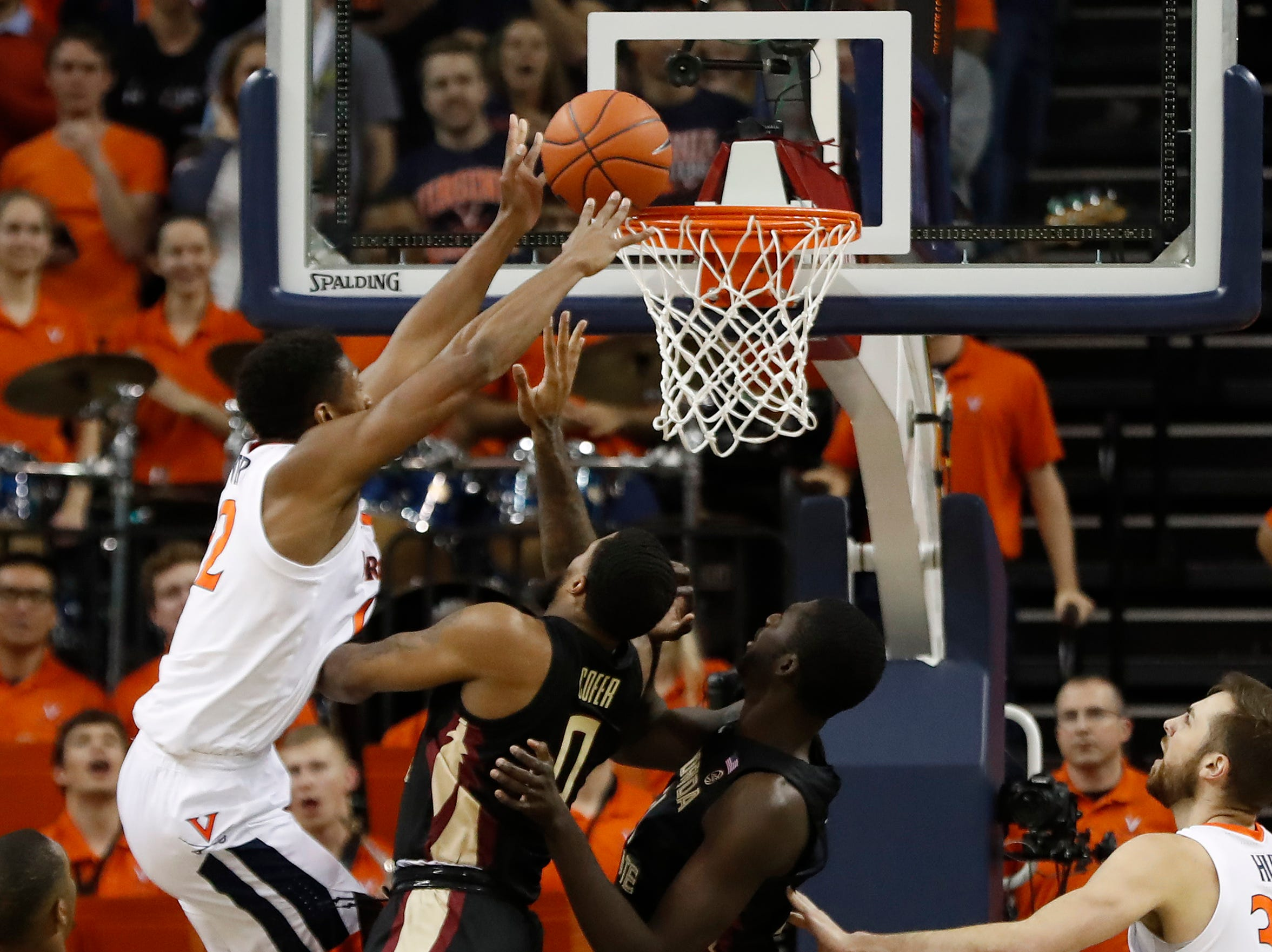 Jan 5, 2019; Charlottesville, VA, USA; Virginia Cavaliers guard De'Andre Hunter (12) is fouled while attempting to dunk the ball by Florida State Seminoles forward Phil Cofer (0) in the first half at John Paul Jones Arena. Mandatory Credit: Geoff Burke-USA TODAY Sports