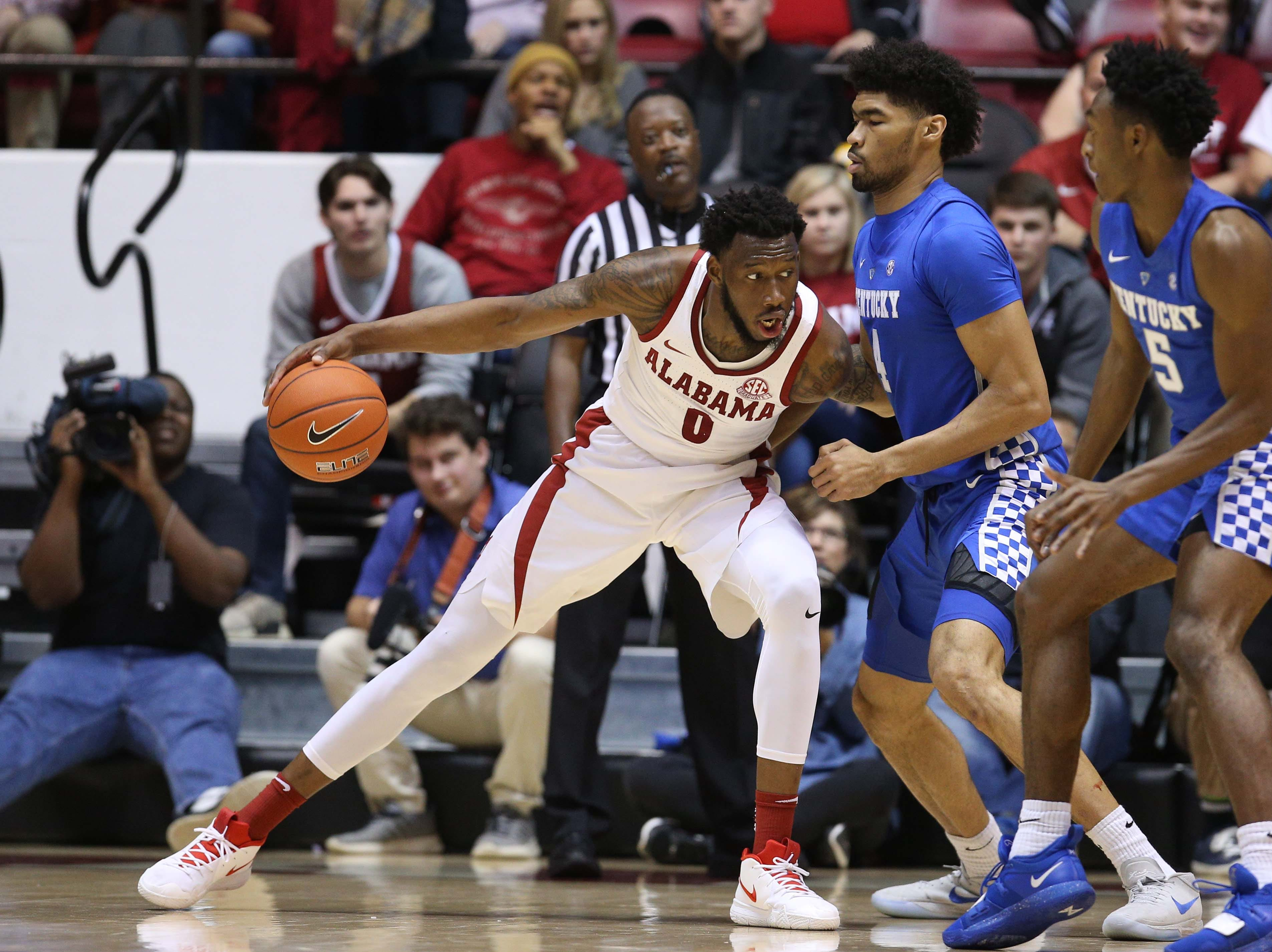 Jan 5, 2019; Tuscaloosa, AL, USA; Alabama Crimson Tide forward Donta Hall (0) pushes to the basket against Kentucky Wildcats forward Nick Richards (4) during the second half at Coleman Coliseum. Mandatory Credit: Marvin Gentry-USA TODAY Sports
