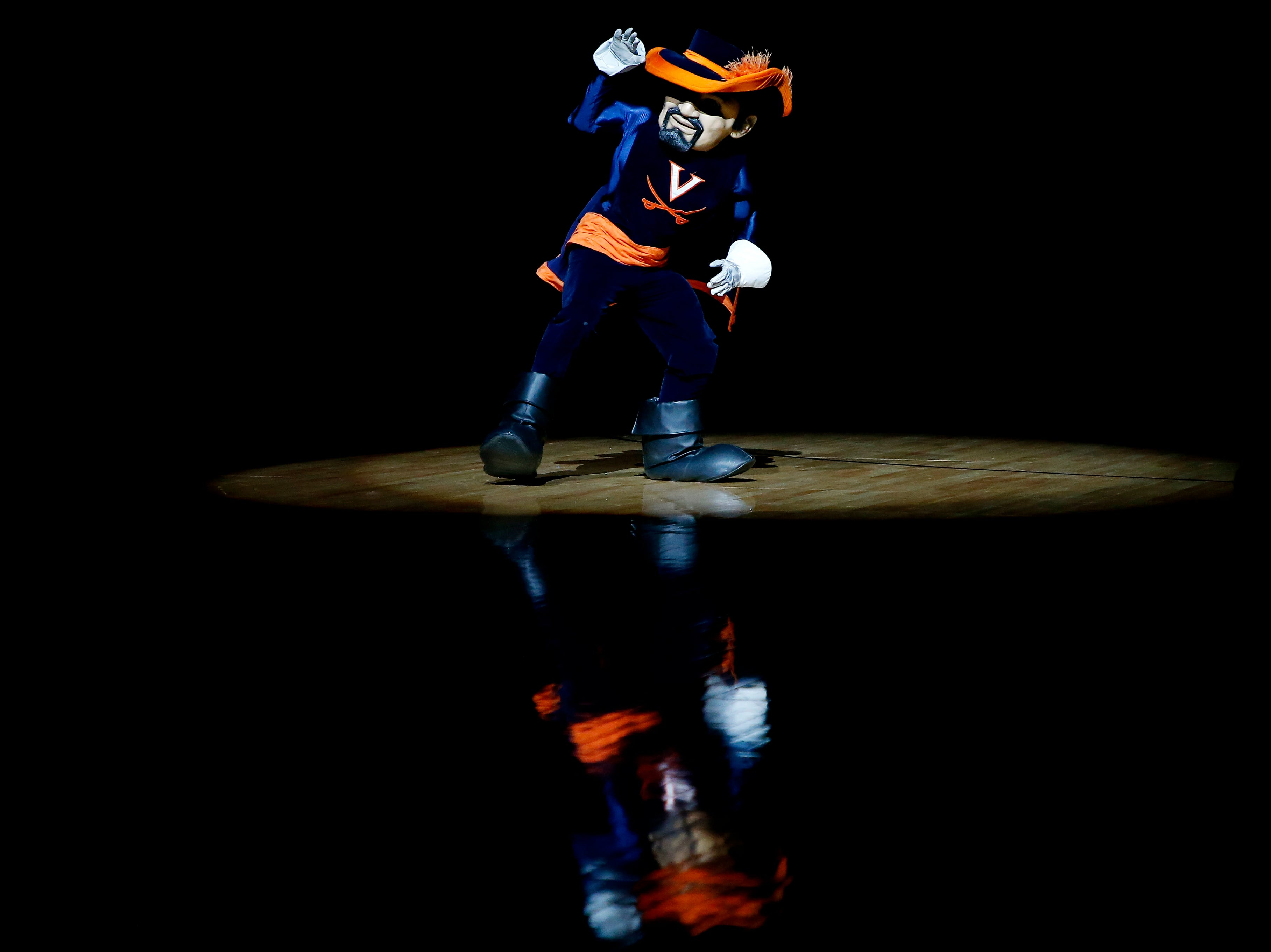 Jan 5, 2019; Charlottesville, VA, USA; Virginia Cavaliers mascot Can Man dances on the court prior to the Cavaliers' game against the Florida State Seminoles at John Paul Jones Arena. Mandatory Credit: Geoff Burke-USA TODAY Sports