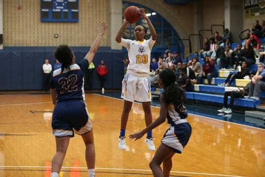 Tallahassee Community College guard Daisha Bradford (20) shoots for three. TCC fell 101-96 in double overtime versus Gulf Coast State College Saturday, Jan. 5, 2019.
