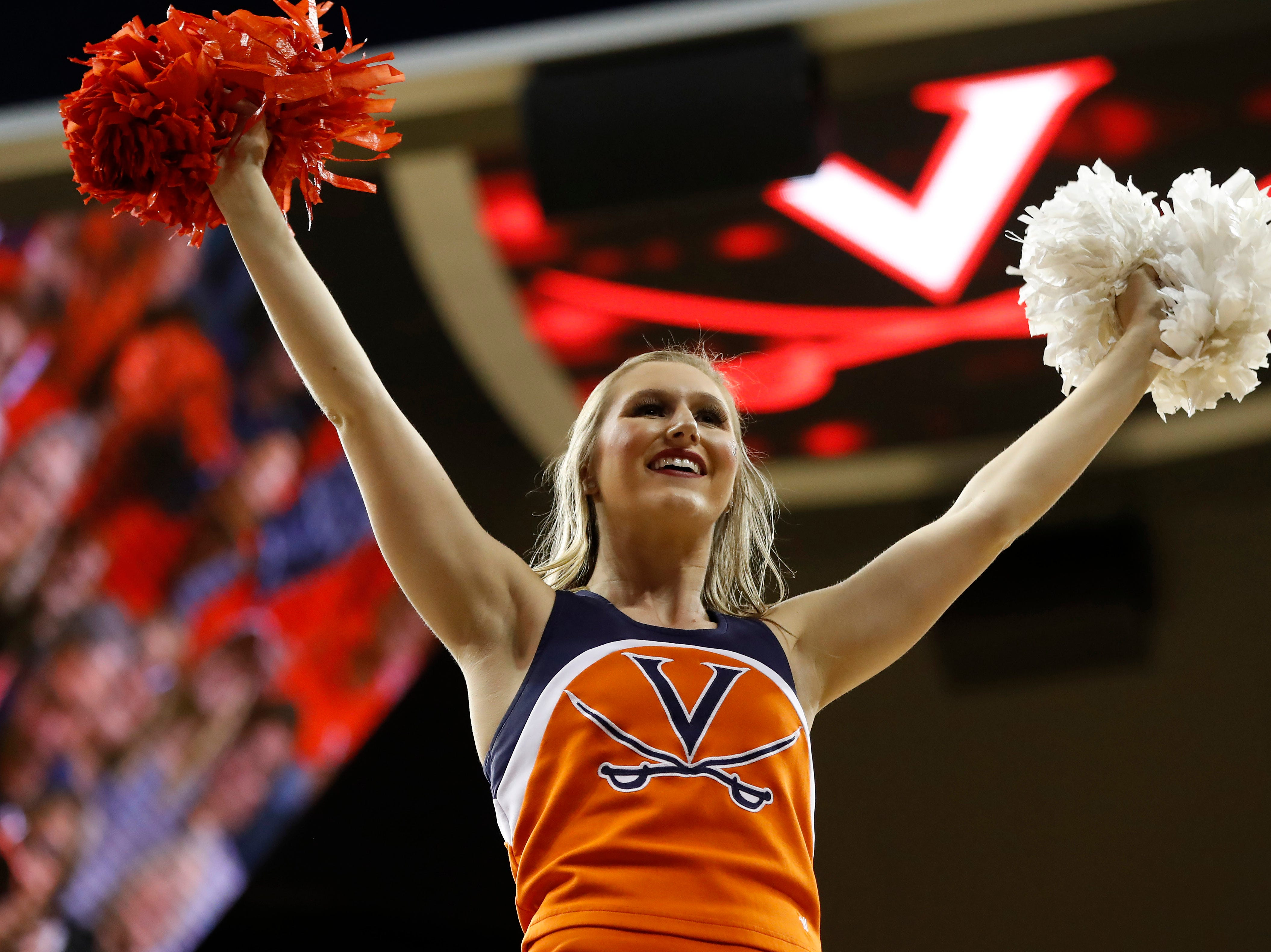 Jan 5, 2019; Charlottesville, VA, USA; A Virginia Cavaliers cheerleader cheers on the court during a timeout against the Florida State Seminoles in the second half at John Paul Jones Arena. Mandatory Credit: Geoff Burke-USA TODAY Sports