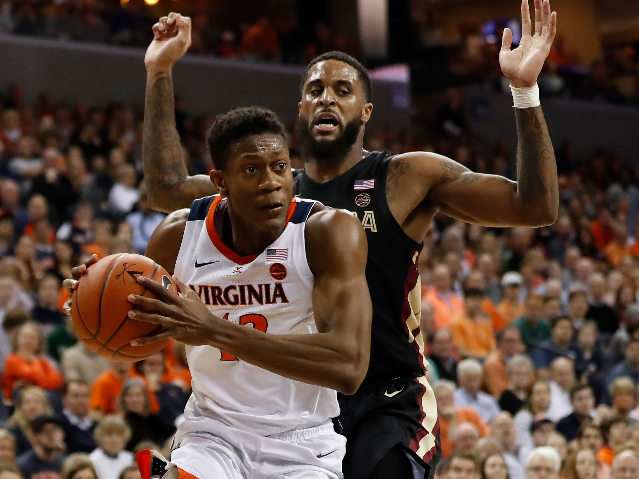 Jan 5, 2019; Charlottesville, VA, USA; Virginia Cavaliers guard De'Andre Hunter (12) drives to the basket past Florida State Seminoles forward Phil Cofer (0) in the second half at John Paul Jones Arena. Mandatory Credit: Geoff Burke-USA TODAY Sports