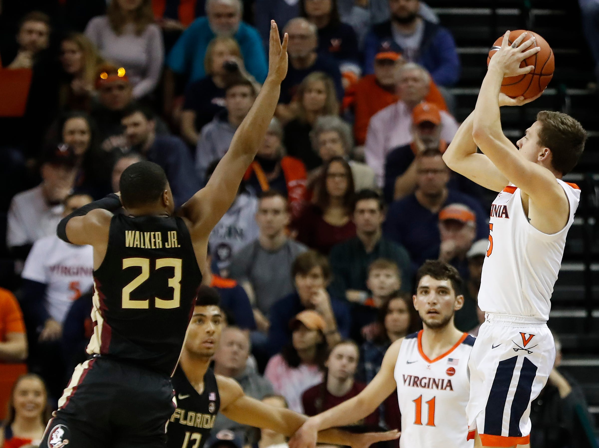 Jan 5, 2019; Charlottesville, VA, USA; Virginia Cavaliers guard Kyle Guy (5) shoots the ball over Florida State Seminoles guard M.J. Walker (23) in the first half at John Paul Jones Arena. Mandatory Credit: Geoff Burke-USA TODAY Sports