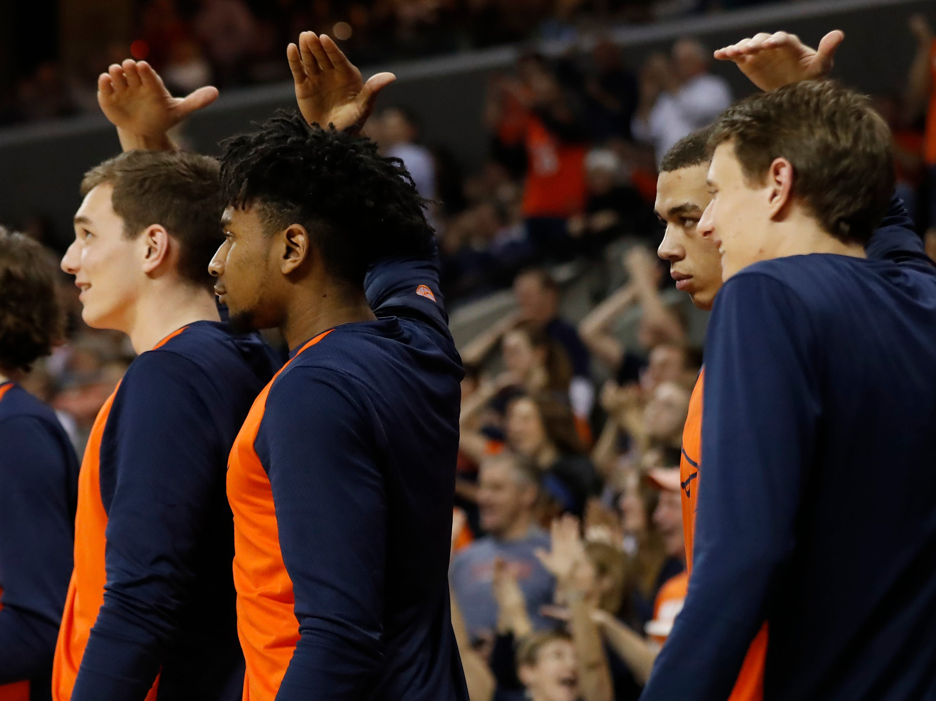 Jan 5, 2019; Charlottesville, VA, USA; Virginia Cavaliers players gesture on the bench after a shot clock violation by  the Florida State Seminoles in the second half at John Paul Jones Arena. Mandatory Credit: Geoff Burke-USA TODAY Sports