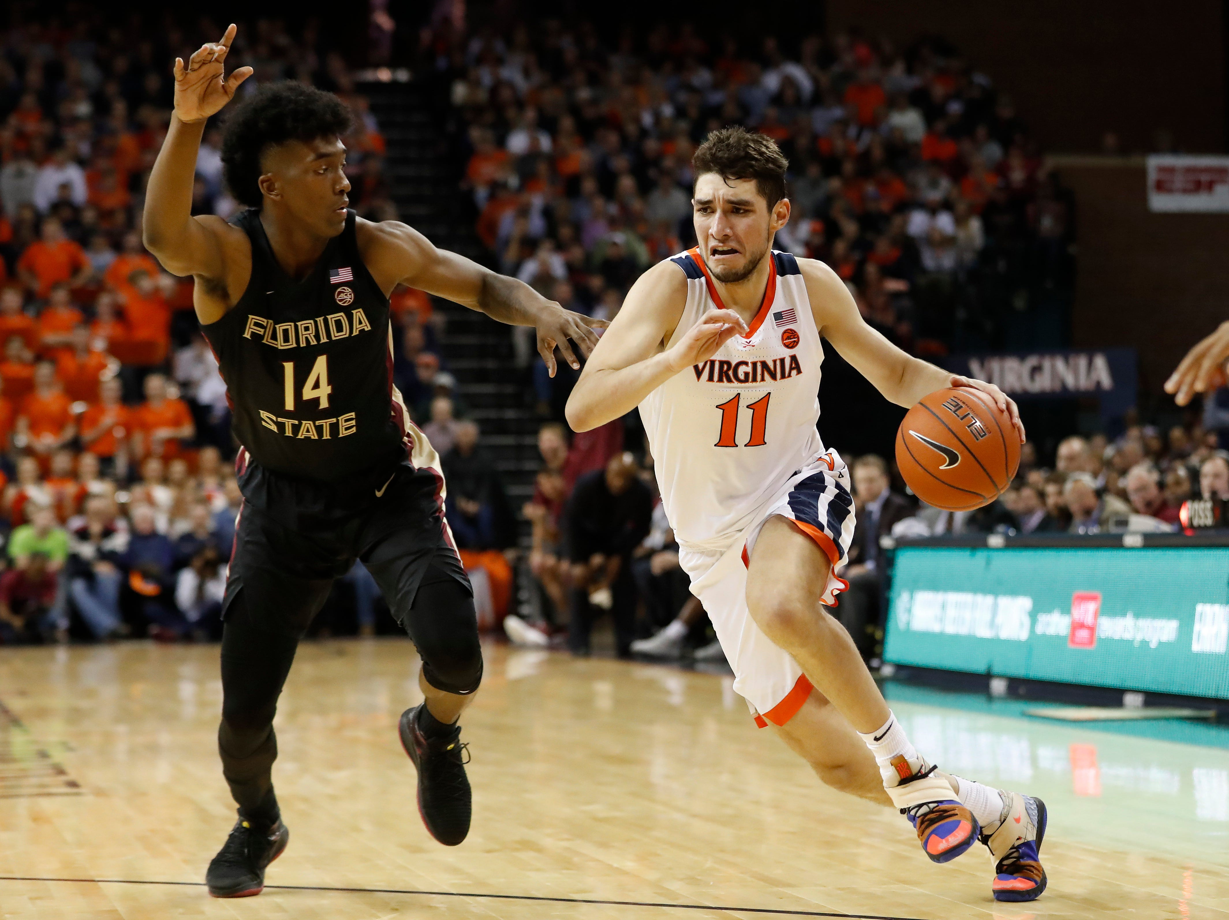 Jan 5, 2019; Charlottesville, VA, USA; Virginia Cavaliers guard Ty Jerome (11) drives to the basket as Florida State Seminoles guard Terance Mann (14) defends in the second half at John Paul Jones Arena. Mandatory Credit: Geoff Burke-USA TODAY Sports