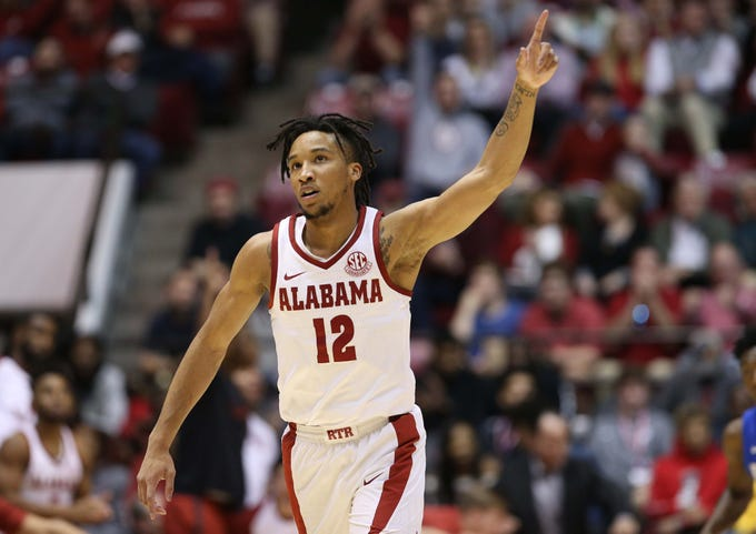 Jan 5, 2019; Tuscaloosa, AL, USA; Alabama Crimson Tide guard Dazon Ingram (12) reacts after making a shot against Kentucky Wildcats during the second half at Coleman Coliseum. Mandatory Credit: Marvin Gentry-USA TODAY Sports
