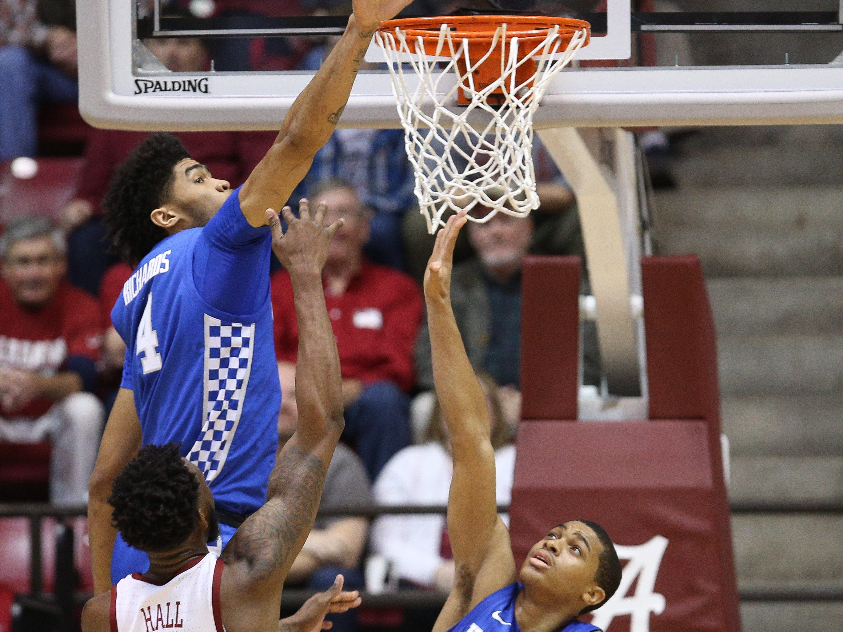Jan 5, 2019; Tuscaloosa, AL, USA; Kentucky Wildcats forward Nick Richards (4) blocks the shot of Alabama Crimson Tide forward Donta Hall (0) during the second half at Coleman Coliseum. Mandatory Credit: Marvin Gentry-USA TODAY Sports