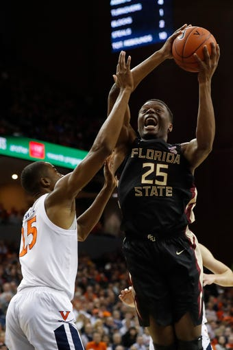 Jan 5, 2019; Charlottesville, VA, USA; Florida State Seminoles forward Mfiondu Kabengele (25) shoots the ball as Virginia Cavaliers forward Mamadi Diakite (25) defends in the first half at John Paul Jones Arena. Mandatory Credit: Geoff Burke-USA TODAY Sports
