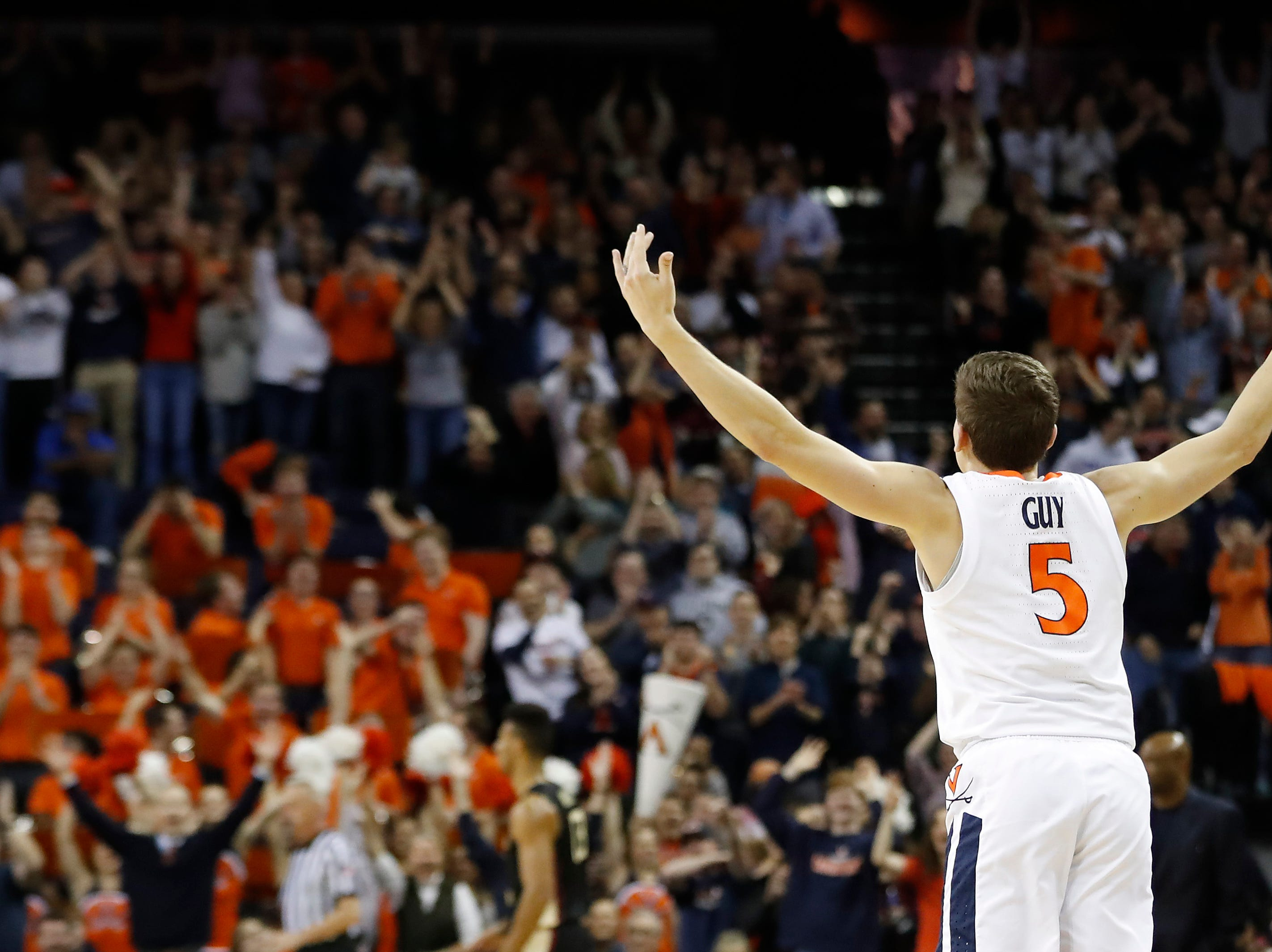 Jan 5, 2019; Charlottesville, VA, USA; Virginia Cavaliers guard Kyle Guy (5) reacts after making a three-point field goal against the Florida State Seminoles in the first half at John Paul Jones Arena. Mandatory Credit: Geoff Burke-USA TODAY Sports