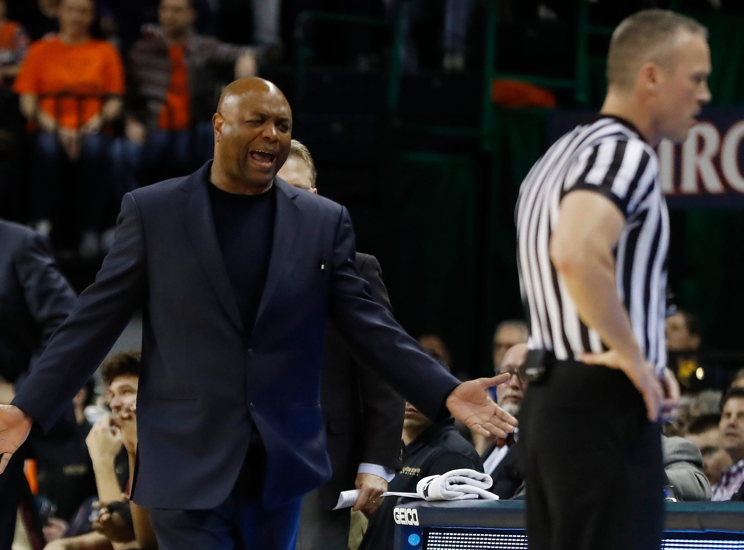 Jan 5, 2019; Charlottesville, VA, USA; Florida State Seminoles head coach Leonard Hamilton gestures to a referee after a foul call against the Virginia Cavaliers in the first half at John Paul Jones Arena. Mandatory Credit: Geoff Burke-USA TODAY Sports