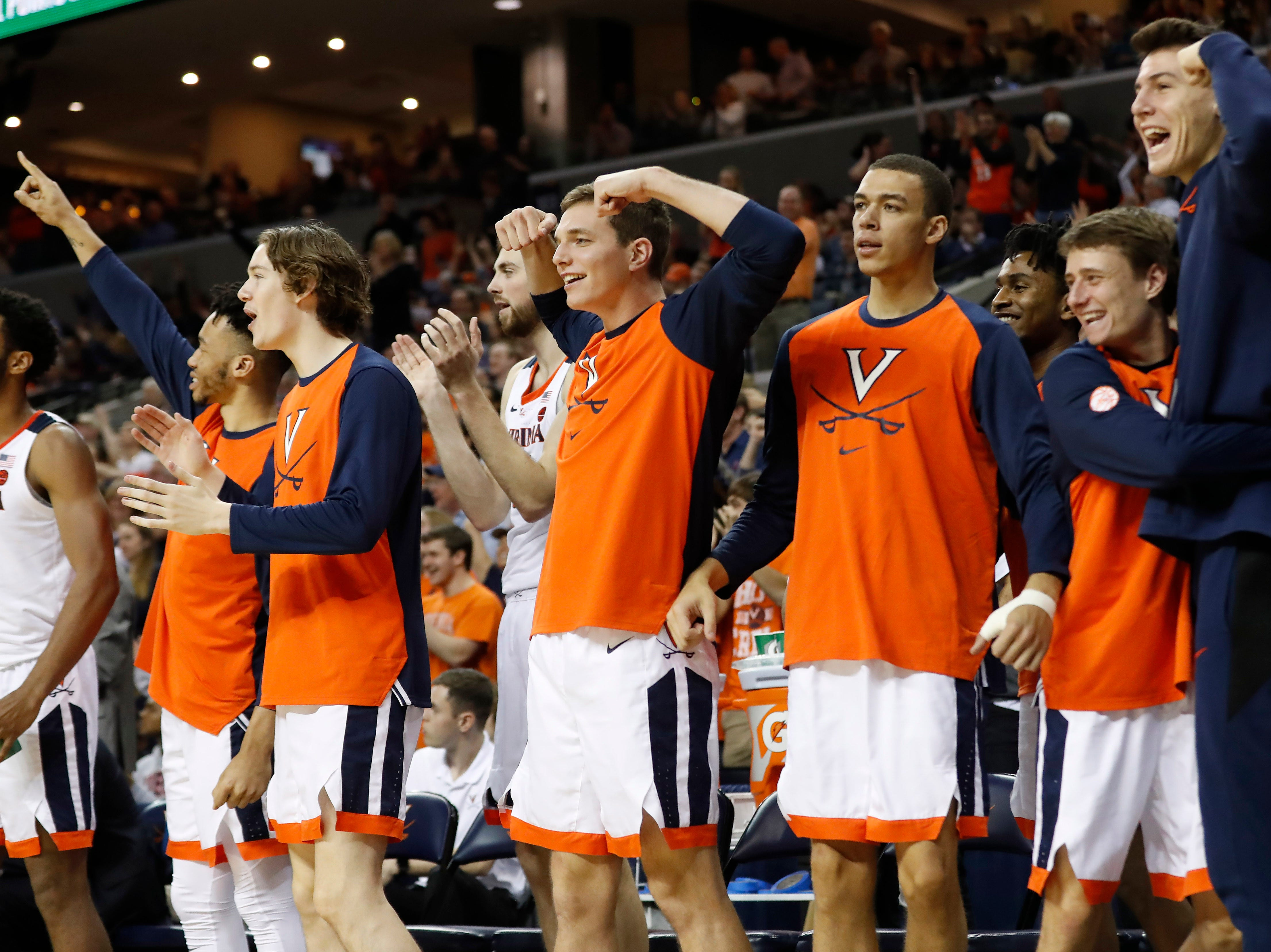 Jan 5, 2019; Charlottesville, VA, USA; Virginia Cavaliers players celebrate on the bench against the Florida State Seminoles in the first half at John Paul Jones Arena. Mandatory Credit: Geoff Burke-USA TODAY Sports