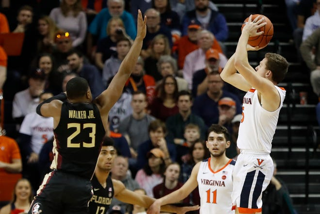 Virginia Cavaliers guard Kyle Guy (5) shoots the ball over Florida State Seminoles guard M.J. Walker (23) in the first half at John Paul Jones Arena.
