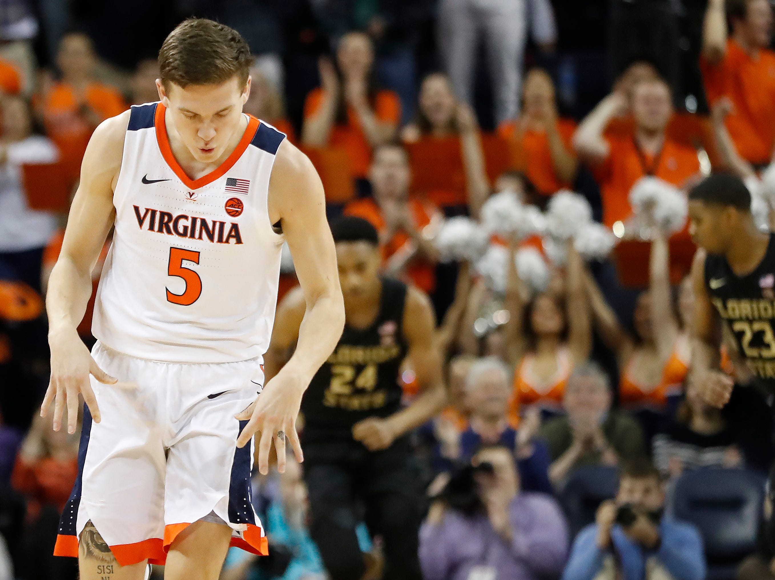 Jan 5, 2019; Charlottesville, VA, USA; Virginia Cavaliers guard Kyle Guy (5) gestures after making a three-point field goal against the Florida State Seminoles in the first half at John Paul Jones Arena. Mandatory Credit: Geoff Burke-USA TODAY Sports
