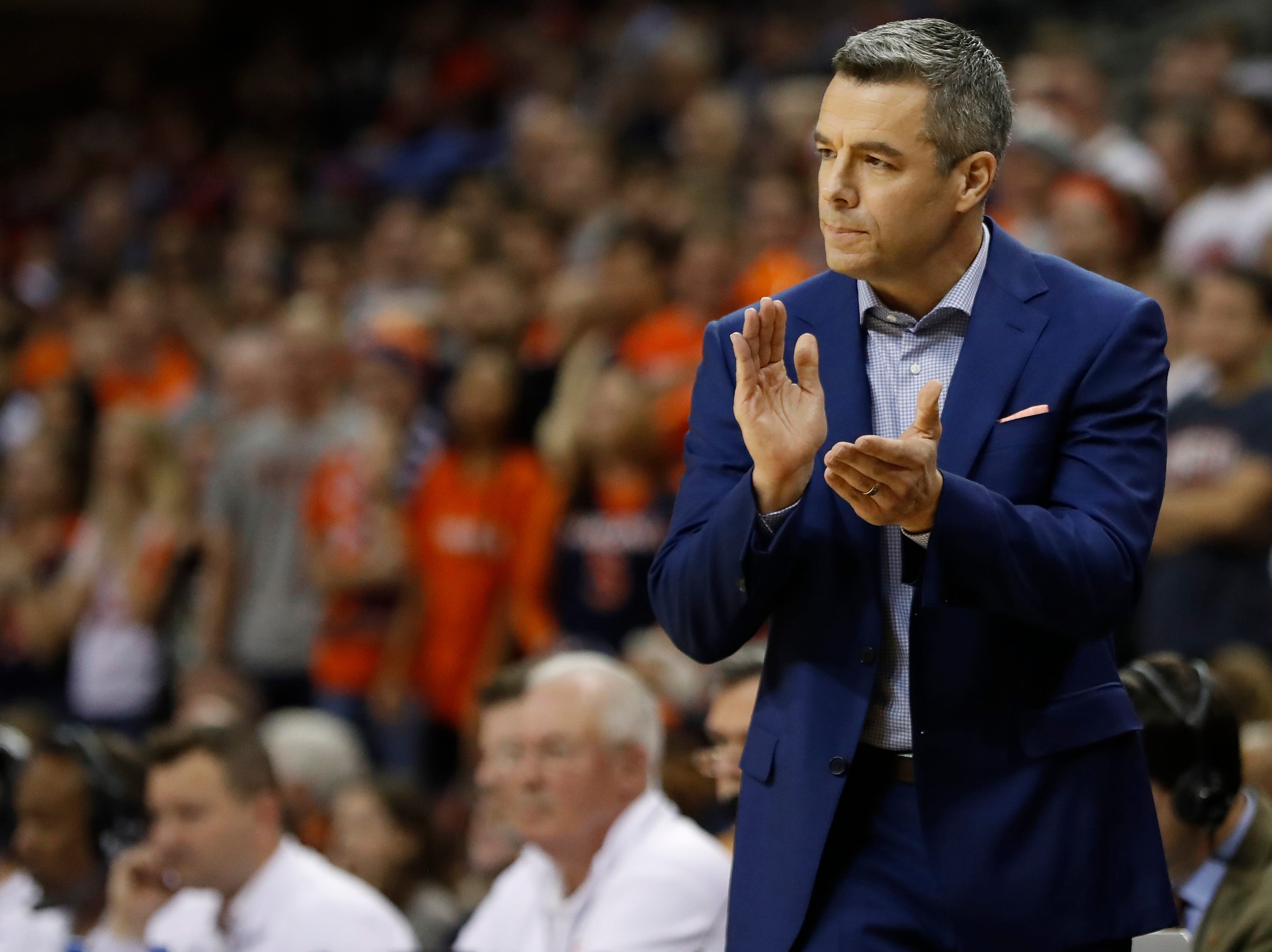 Jan 5, 2019; Charlottesville, VA, USA; Virginia Cavaliers head coach Tony Bennett claps from the bench against the Florida State Seminoles in the first half at John Paul Jones Arena. Mandatory Credit: Geoff Burke-USA TODAY Sports