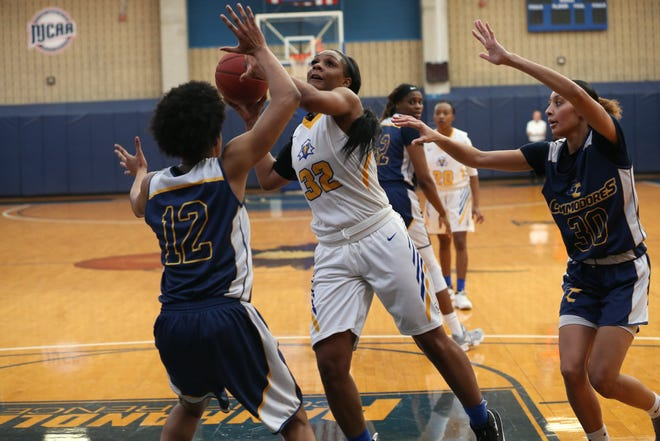 Tallahassee Community College Eagles forward Jamyra McChristine pushes the ball inside versus Gulf Coast State College.