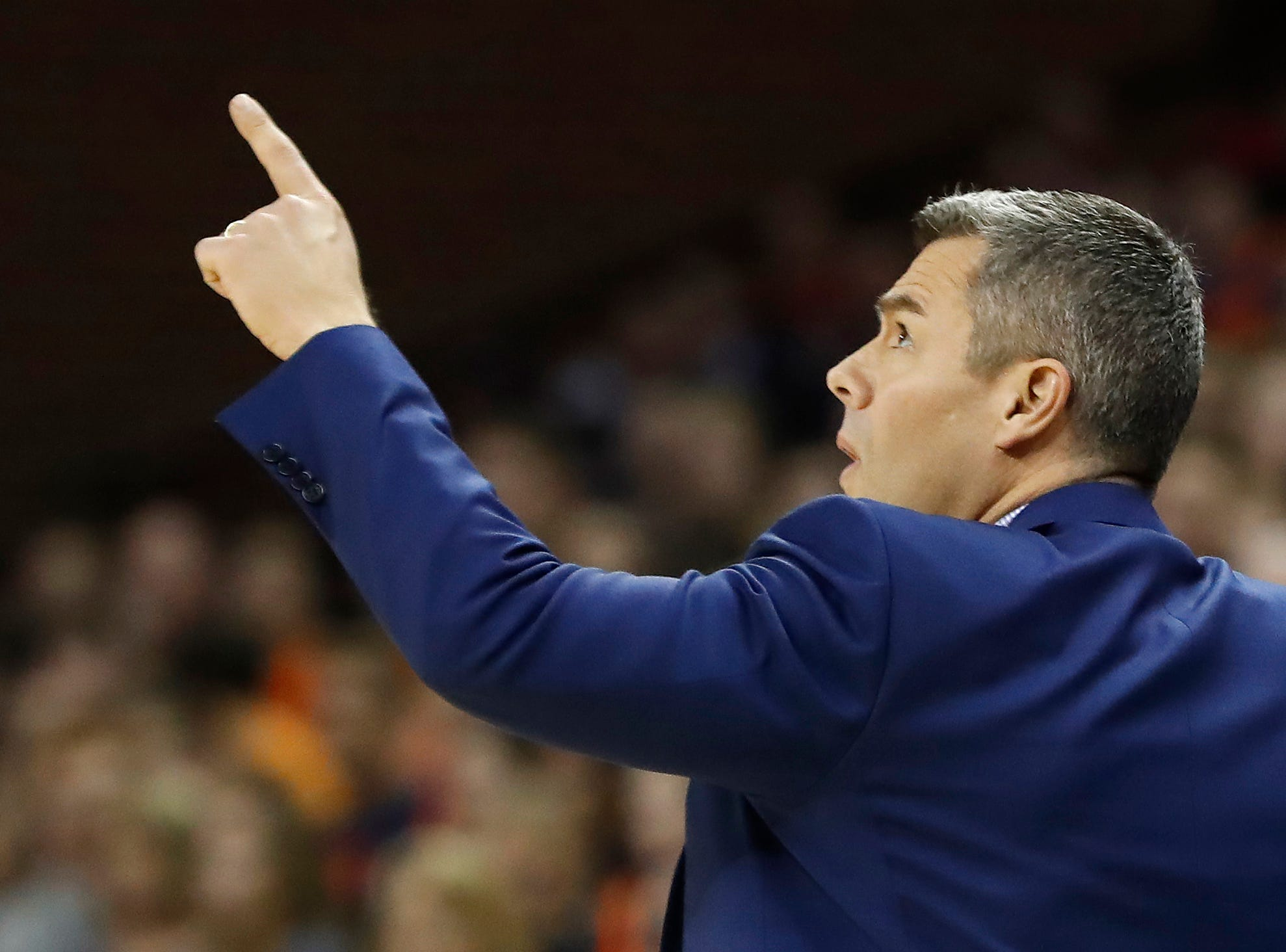 Jan 5, 2019; Charlottesville, VA, USA; Virginia Cavaliers head coach Tony Bennett gestures to the video board from the bench against the Florida State Seminoles in the first half at John Paul Jones Arena. Mandatory Credit: Geoff Burke-USA TODAY Sports