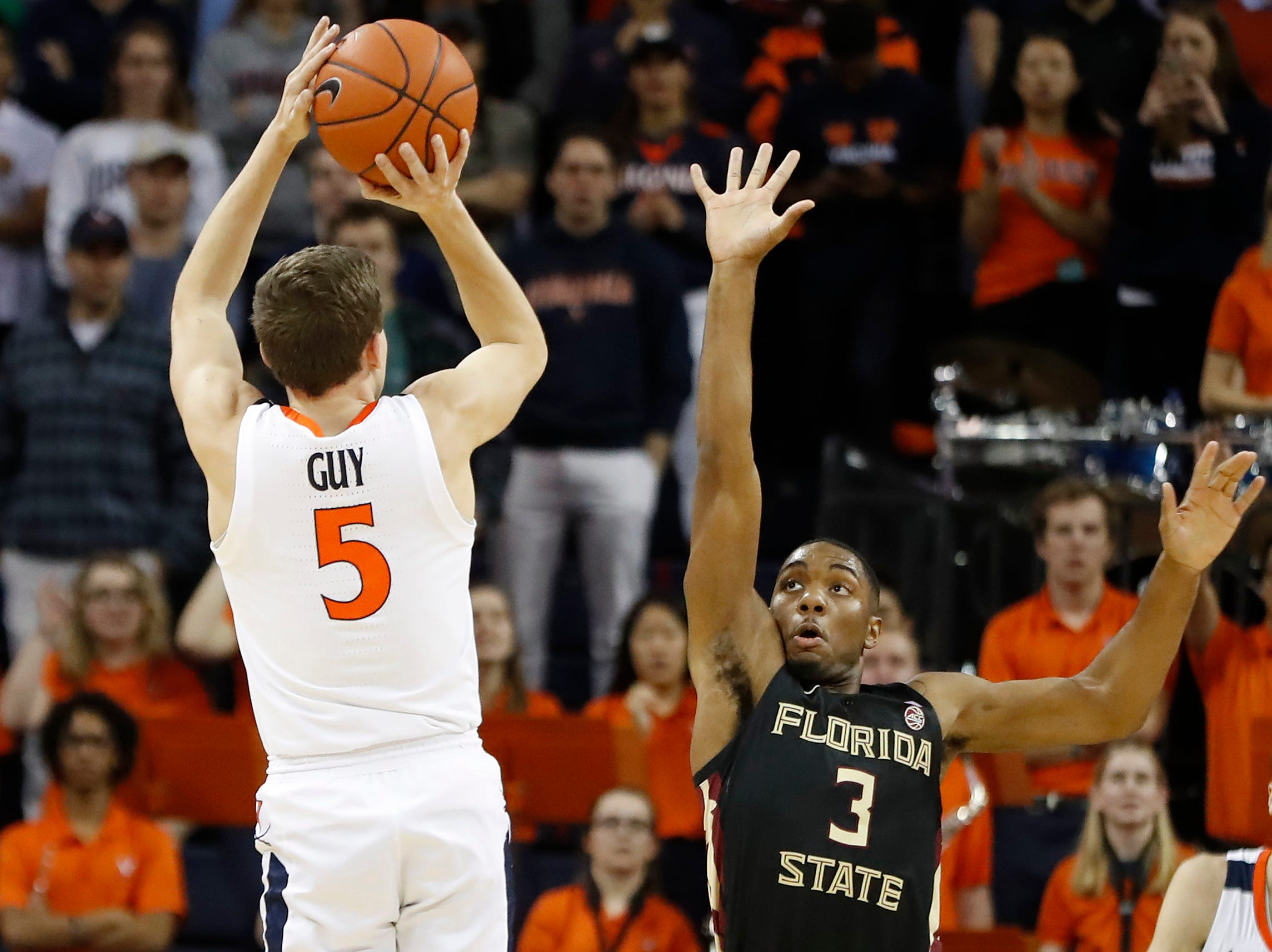 Jan 5, 2019; Charlottesville, VA, USA; Virginia Cavaliers guard Kyle Guy (5) makes a three-point field goal over Florida State Seminoles guard Trent Forrest (3) in the first half at John Paul Jones Arena. Mandatory Credit: Geoff Burke-USA TODAY Sports