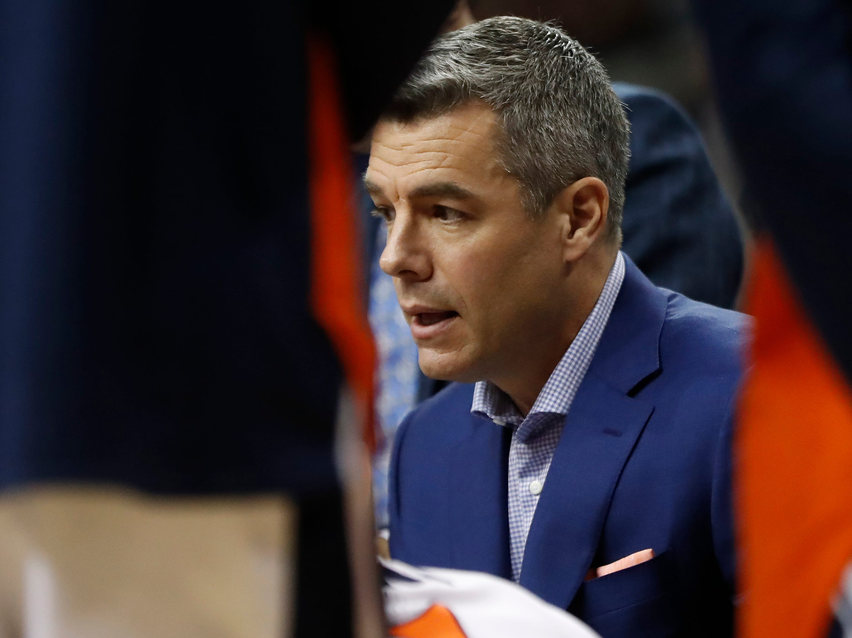 Jan 5, 2019; Charlottesville, VA, USA; Virginia Cavaliers head coach Tony Bennett talks to his team in a huddle during a timeout against the Florida State Seminoles in the second half at John Paul Jones Arena. Mandatory Credit: Geoff Burke-USA TODAY Sports