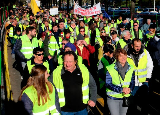 Yellow vest protestors demonstrate in Bayonne, southwestern France, Saturday, Jan. 5, 2019. Hundreds of protesters were trying to breathe new life into France's apparently waning yellow vest movement with marches in Paris and gatherings in other cities, but numbers appeared down on their first demonstration of the new year. (AP Photo/Bob Edme)