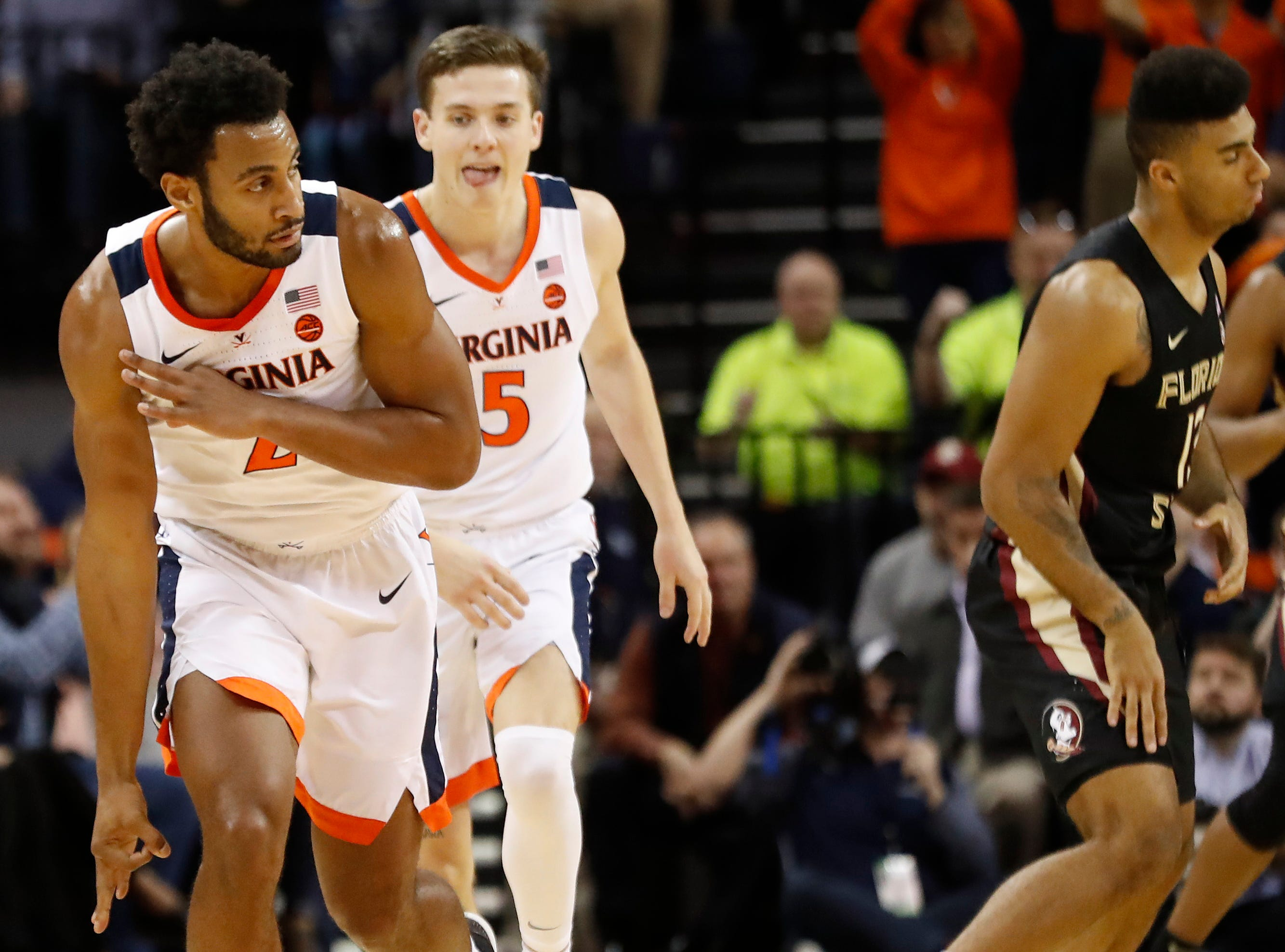 Jan 5, 2019; Charlottesville, VA, USA; Virginia Cavaliers guard Braxton Key (2) celebrates in front of Cavaliers guard Kyle Guy (5) after making a three-point field goal against the Florida State Seminoles in the first half at John Paul Jones Arena. Mandatory Credit: Geoff Burke-USA TODAY Sports
